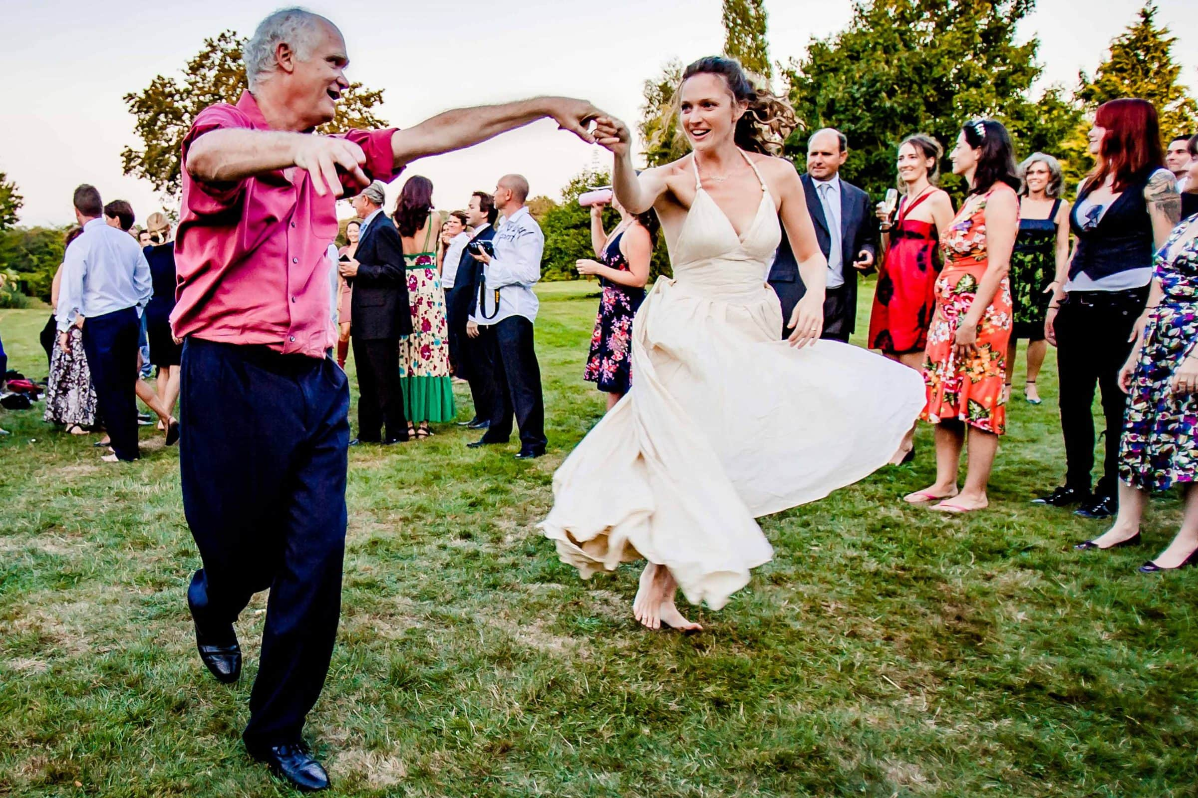 Bride dancing barefoot in Normandy France at Gorgeous Chateau Wedding