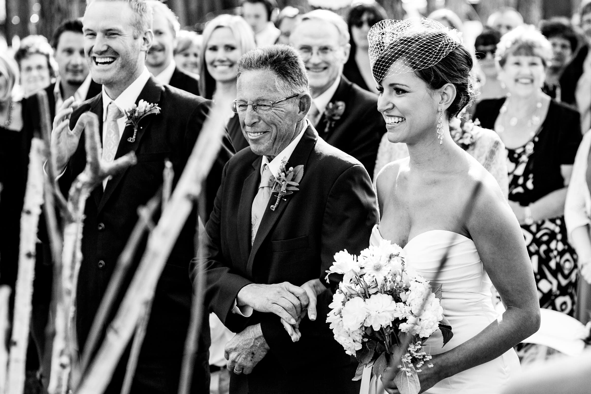 Emotional entrance with bride and father and groom during their Five Pine Lodge Wedding ceremony in Sisters Oregon near Bend in Central Oregon
