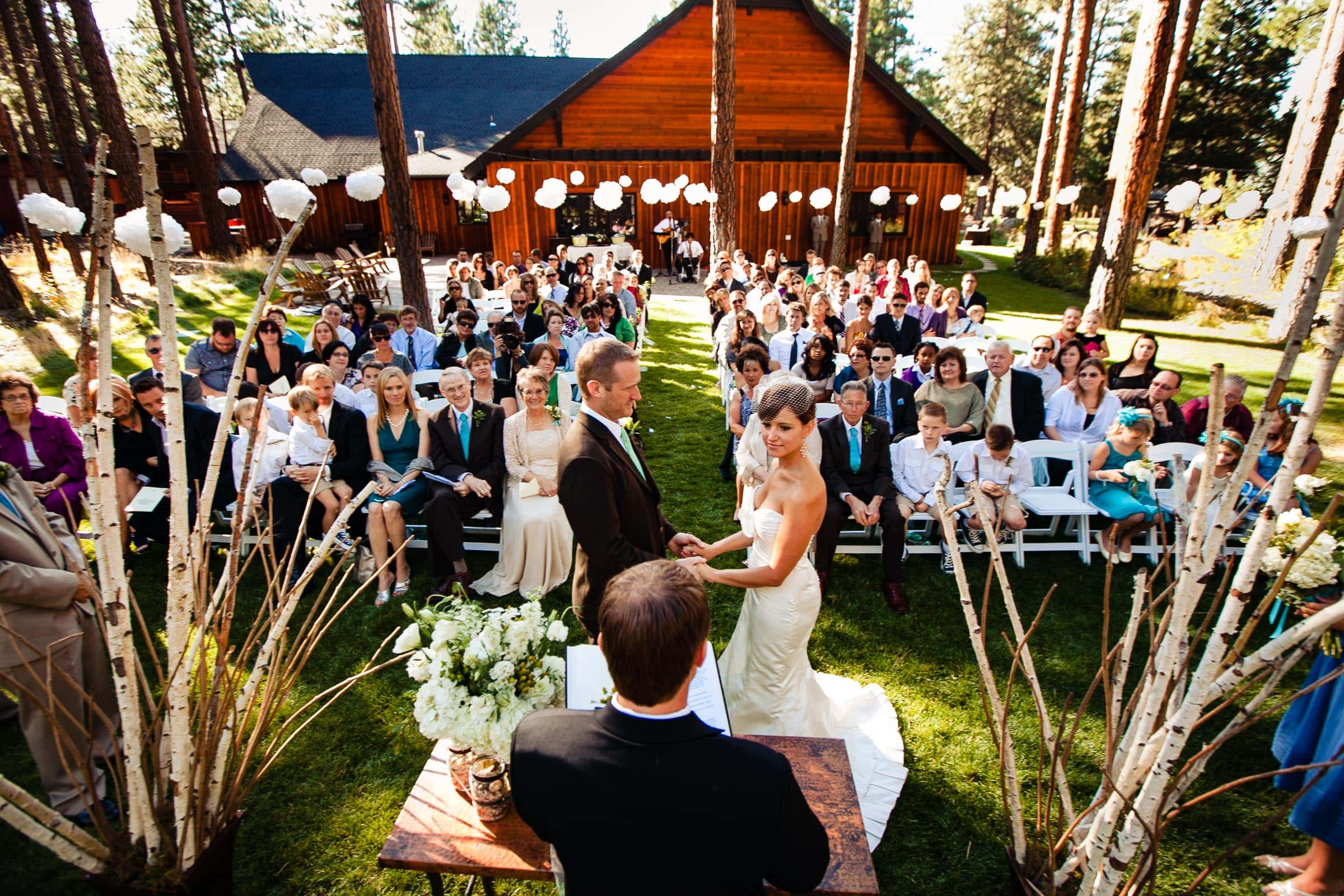 Five Pine Lodge Wedding ceremony with bride and groom and all guests in Sisters Oregon near Bend