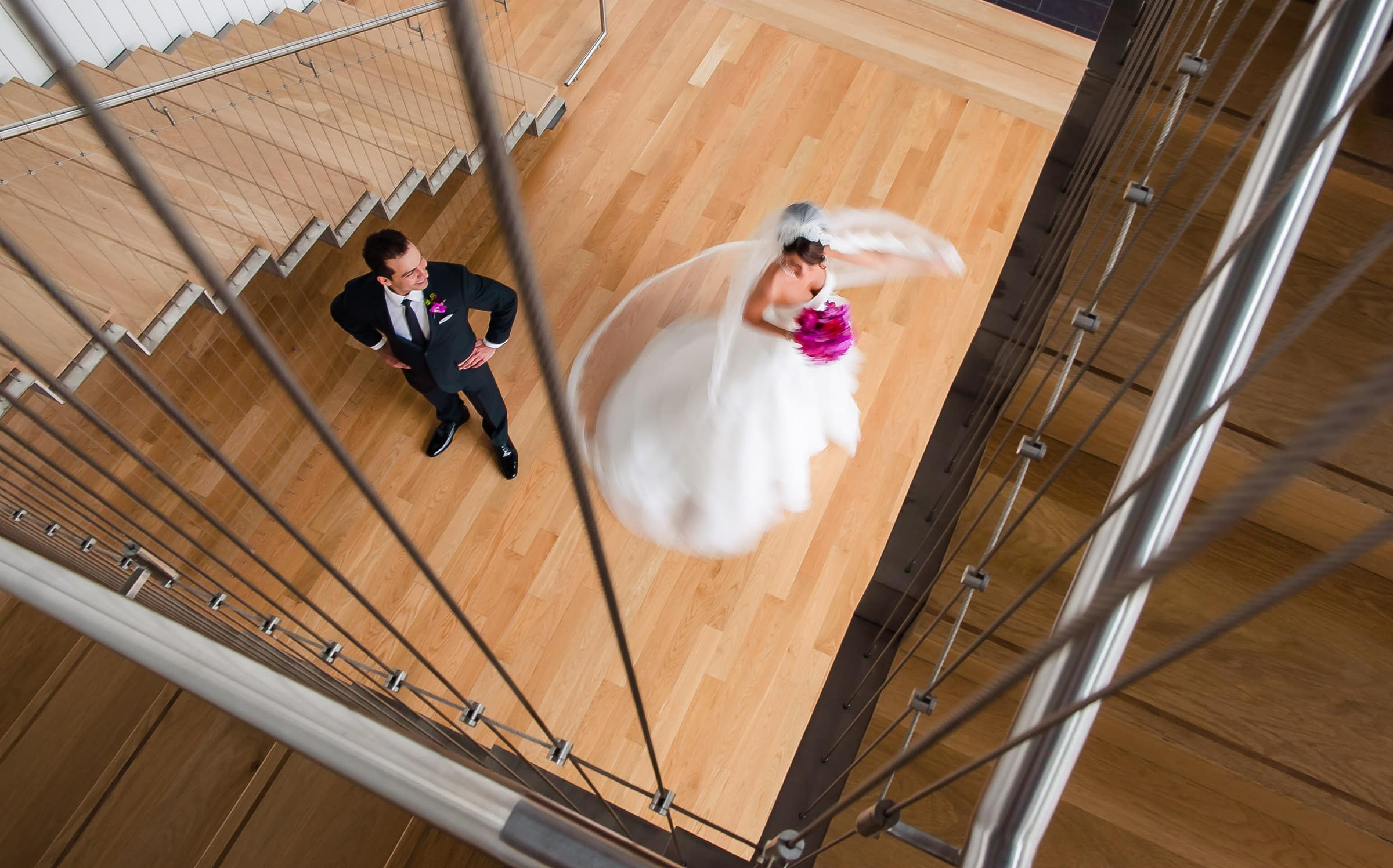 Bride spinning with groom in Indigo building before St Marys Cathedral wedding and Pure Space