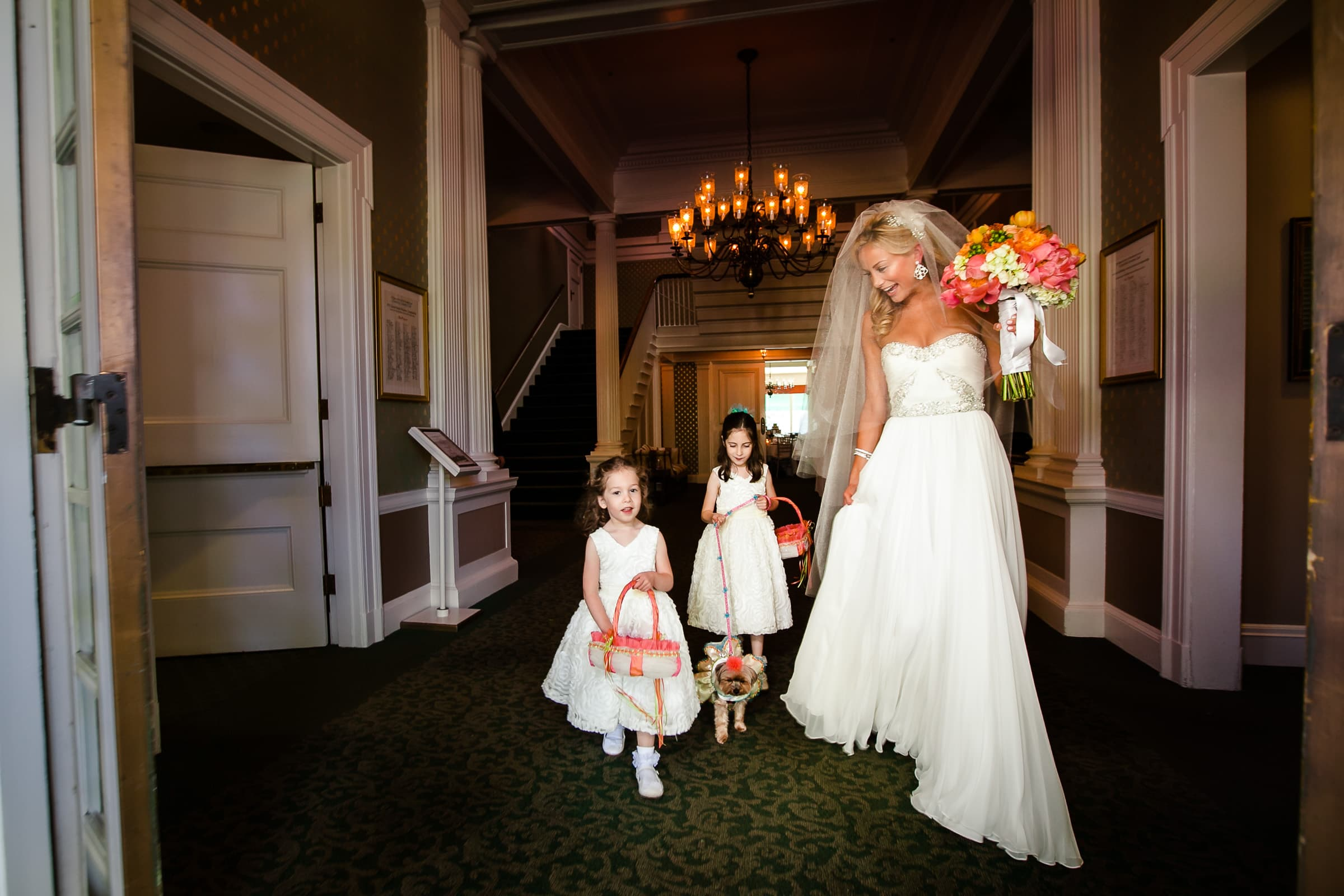 Bride walking with children into her Waverley Country Club wedding in Lake Oswego, Oregon just outside Portland