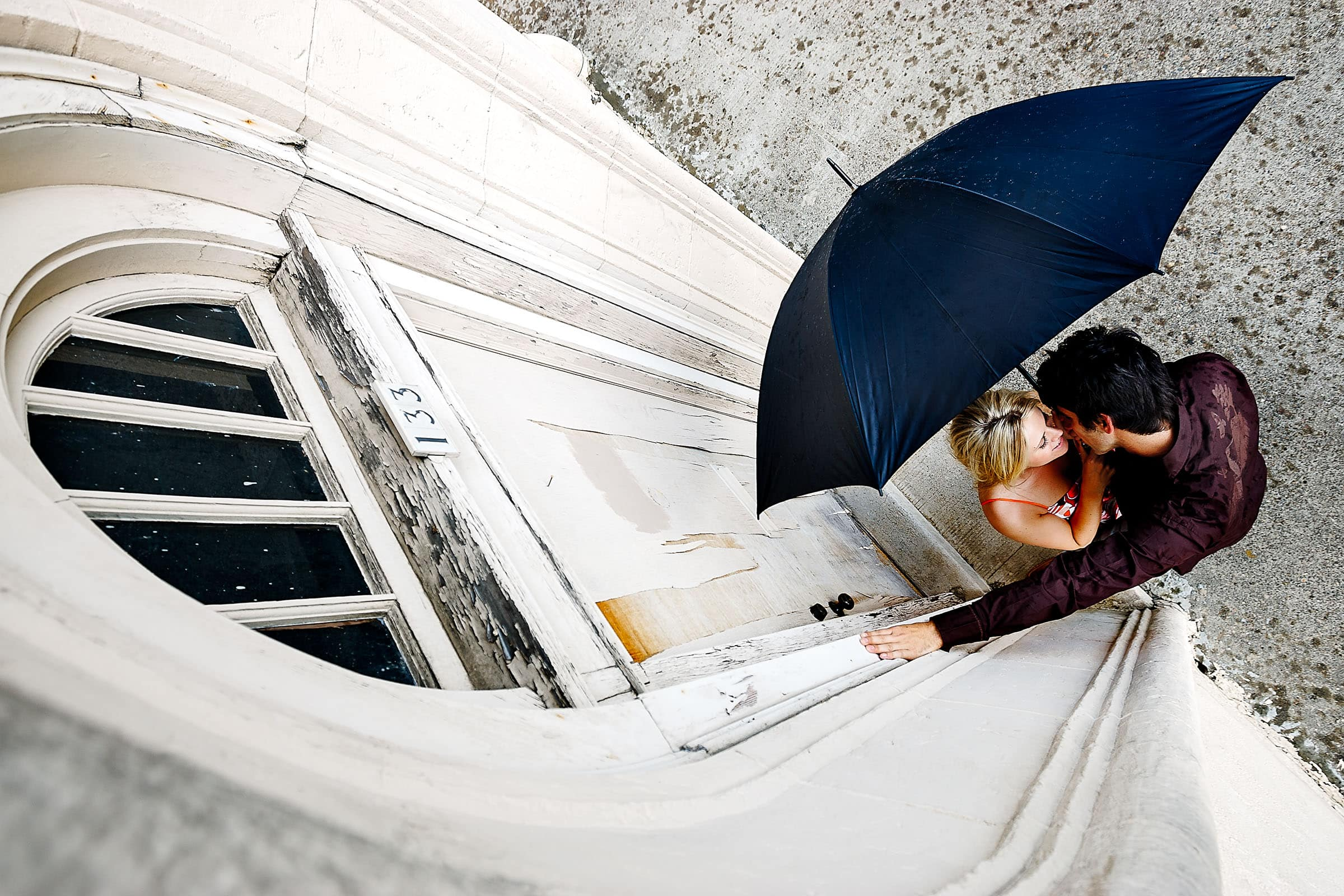 Fun portland engagement photo with umbrella. Worlds Best Wedding Photos