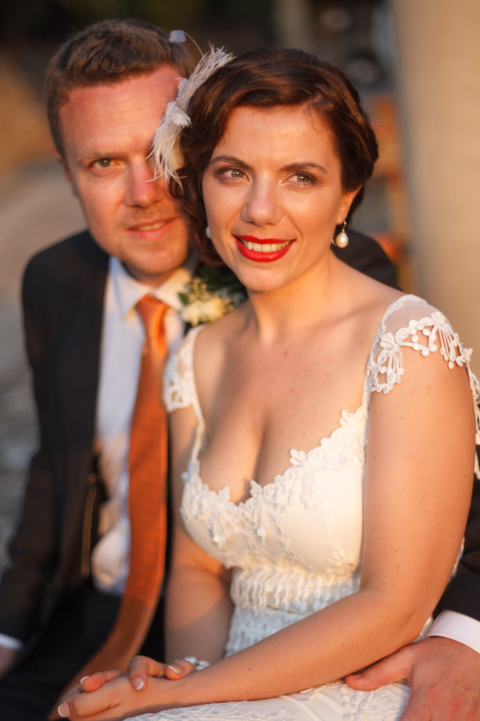Bride and groom portrait with warm sunlight on their faces just after their Sicily Wedding ceremony in Milazzo, Italy