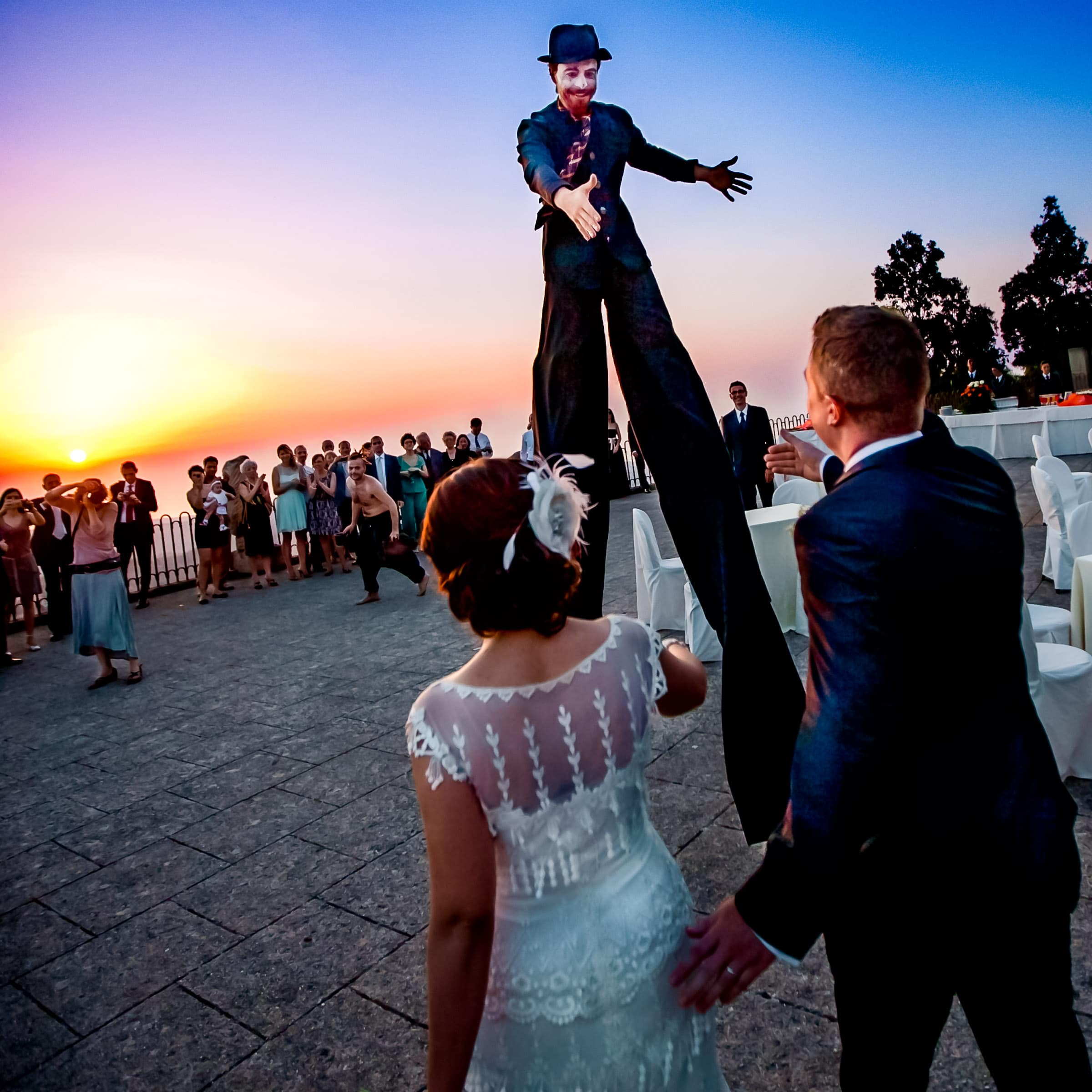 Circus clown surprise greeting bride and groom at during their Sicily Wedding at Parco Museo Jalari