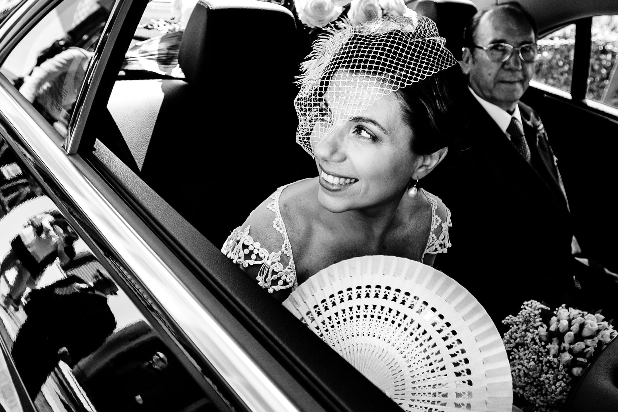 Bride with headpiece in car before her Sicily wedding in Milazzo, Italy