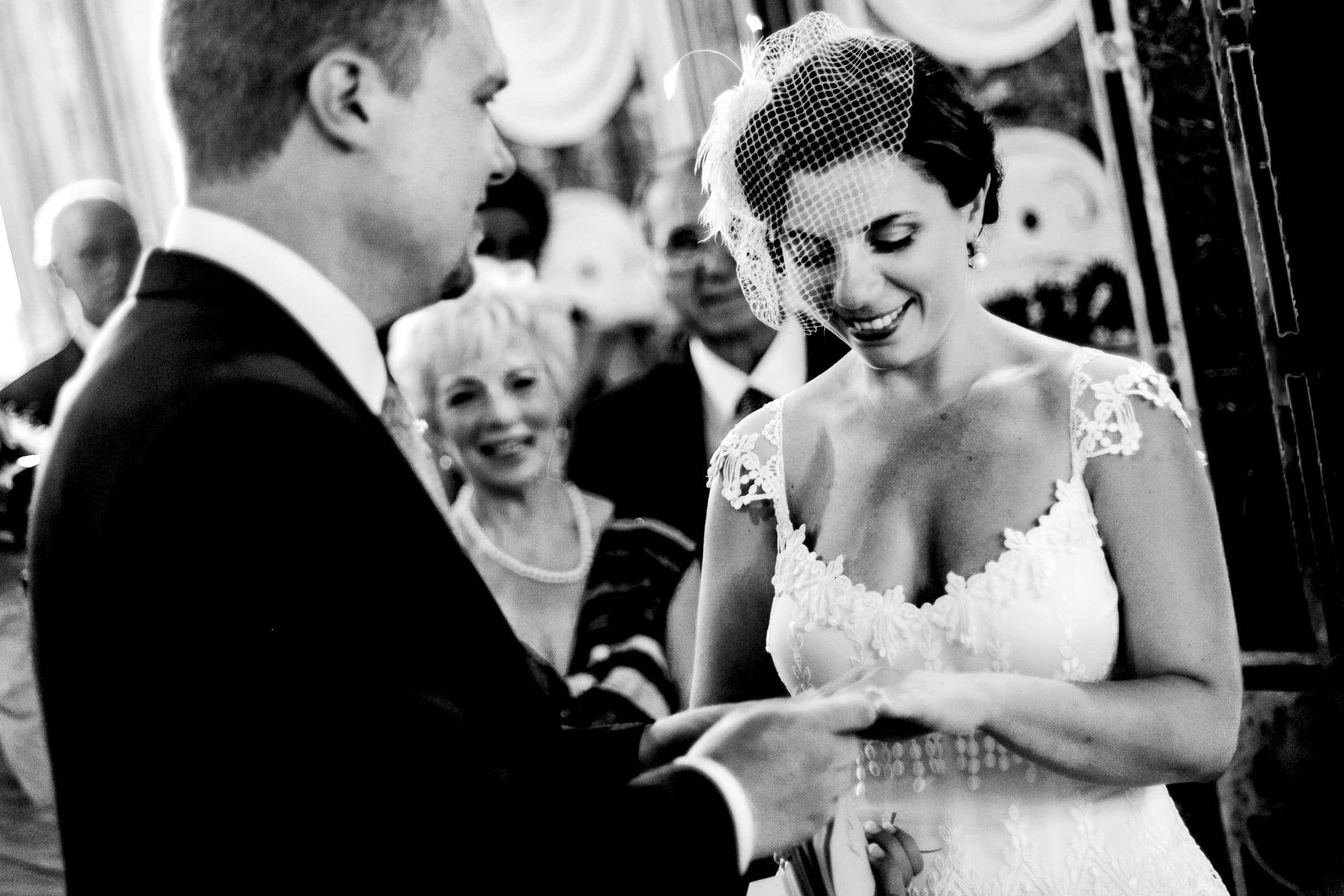 Bride receiving her ring from her groom during their Sicily wedding in Milazzo, Italy