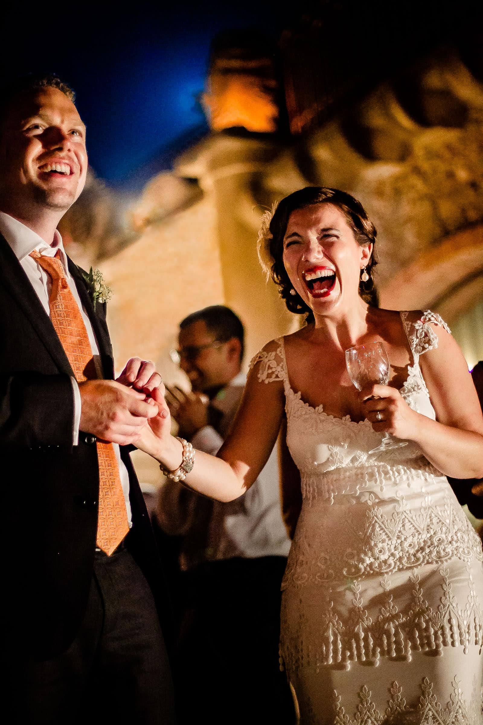 Bride hysterically laughing during Sicily wedding reception