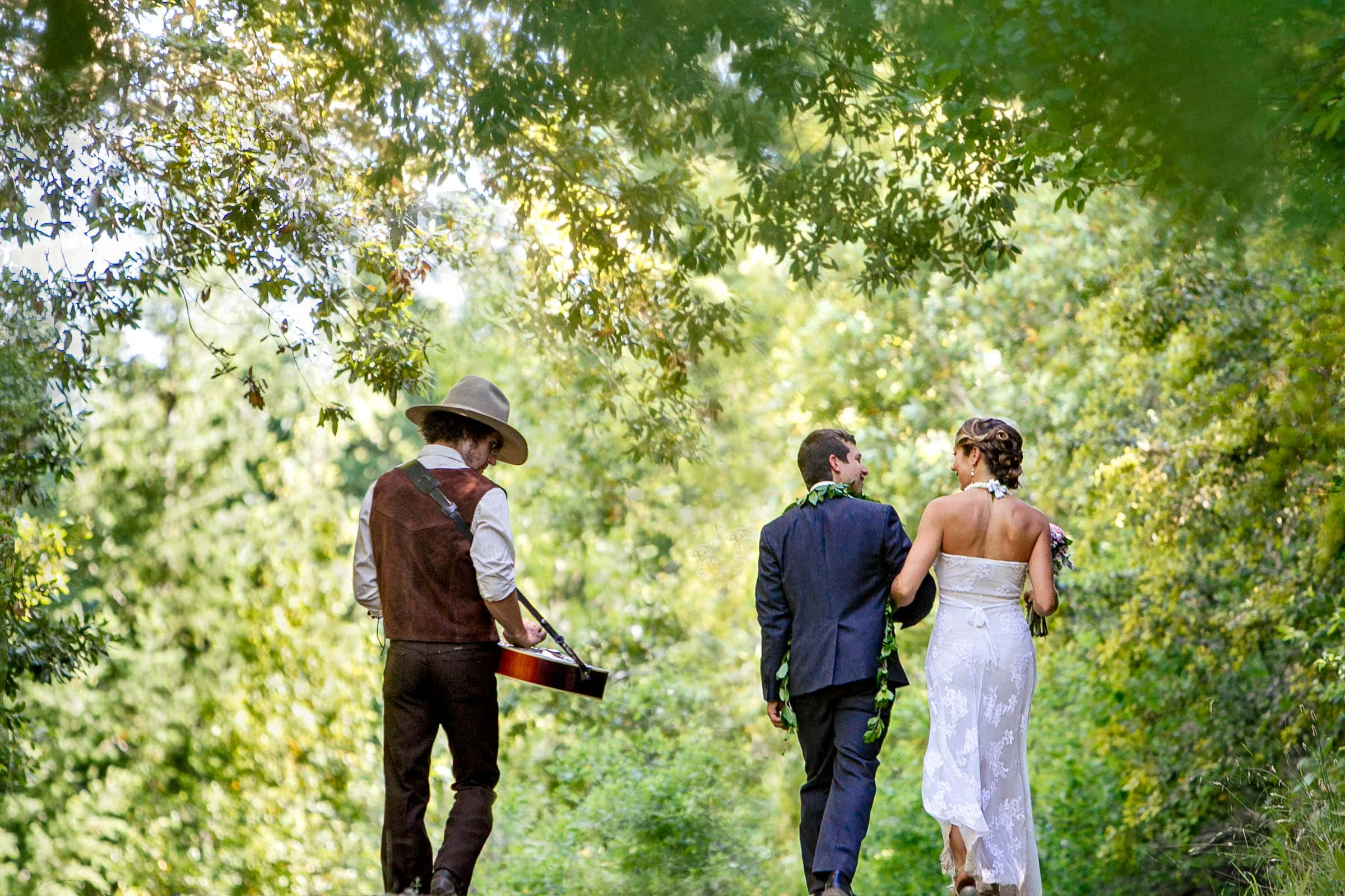 A bride and groom walking together toward their Humboldt California wedding reception at Beginnings Briceland