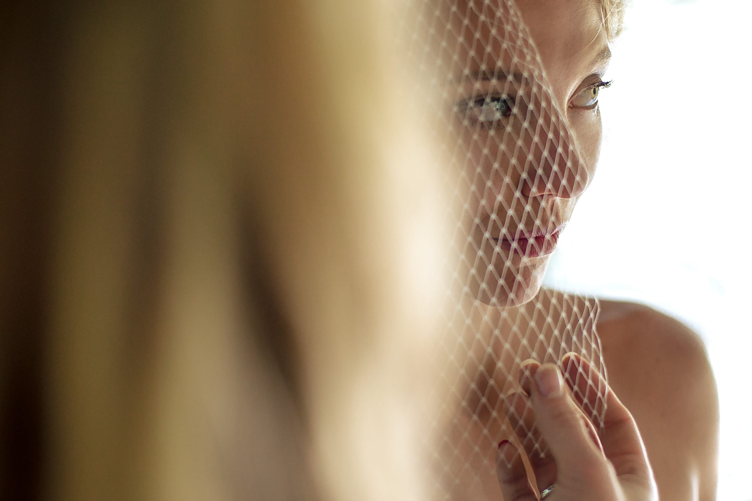 An intimate photo of gorgeous bride with her veil getting ready for her Humboldt California wedding at Beginnings Briceland