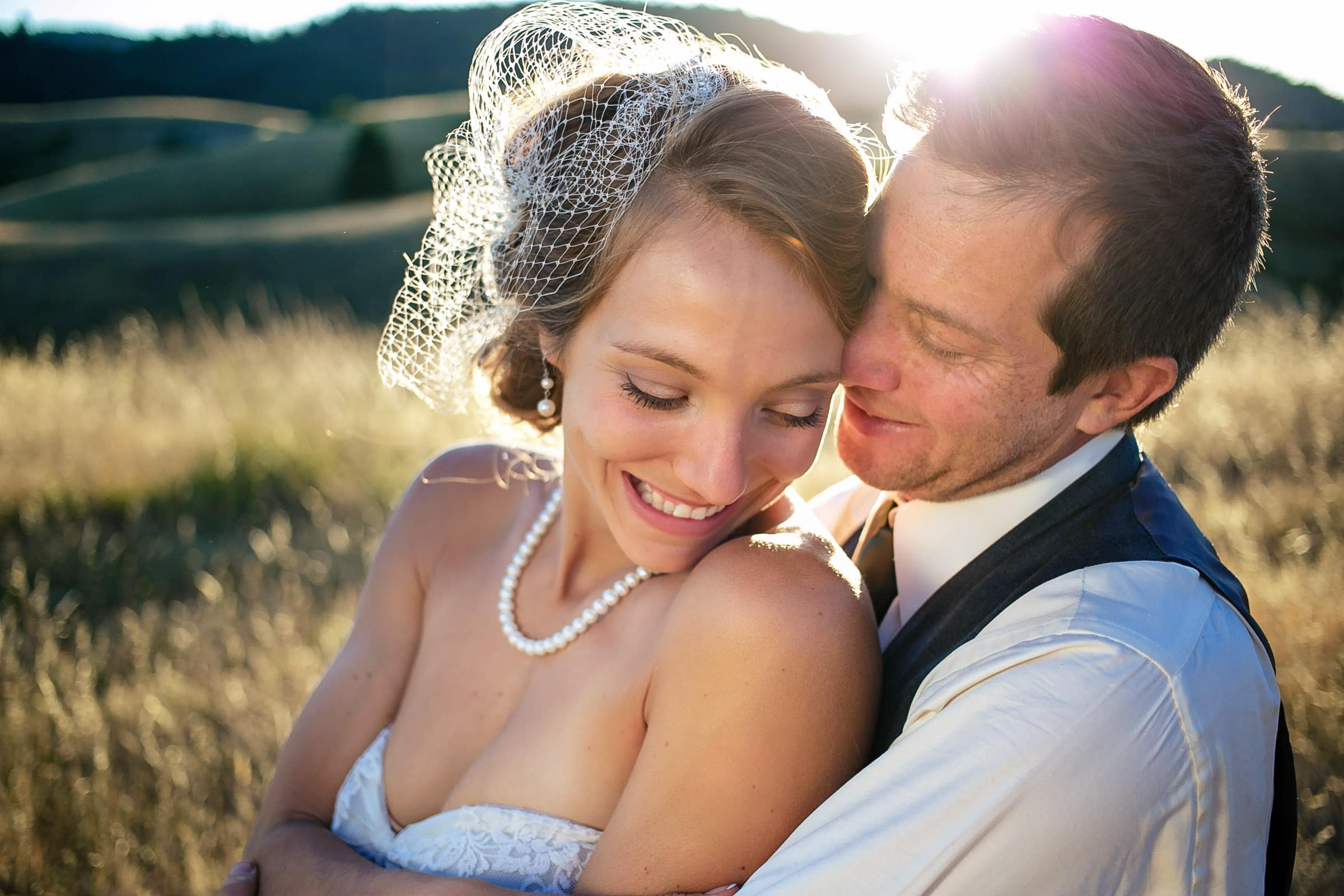 A close up intimate photo of a super happy and connected bride and groom during their Humboldt California wedding at Beginnings Briceland