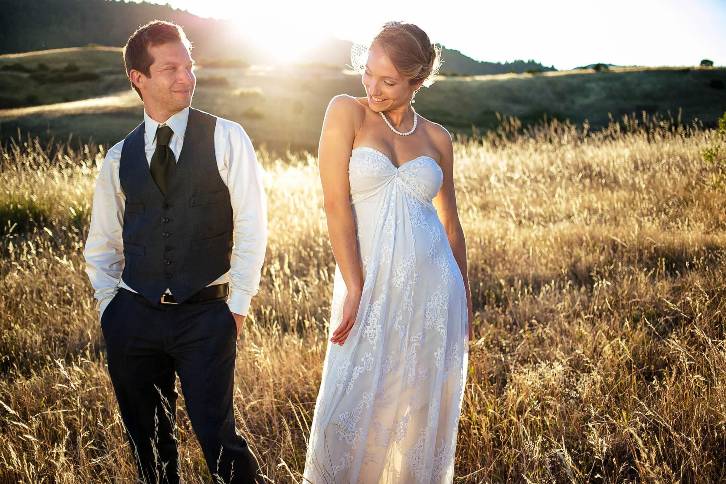 a bride and groom flirting with each other at sunset during their Humboldt California wedding sunset at Beginnings Briceland