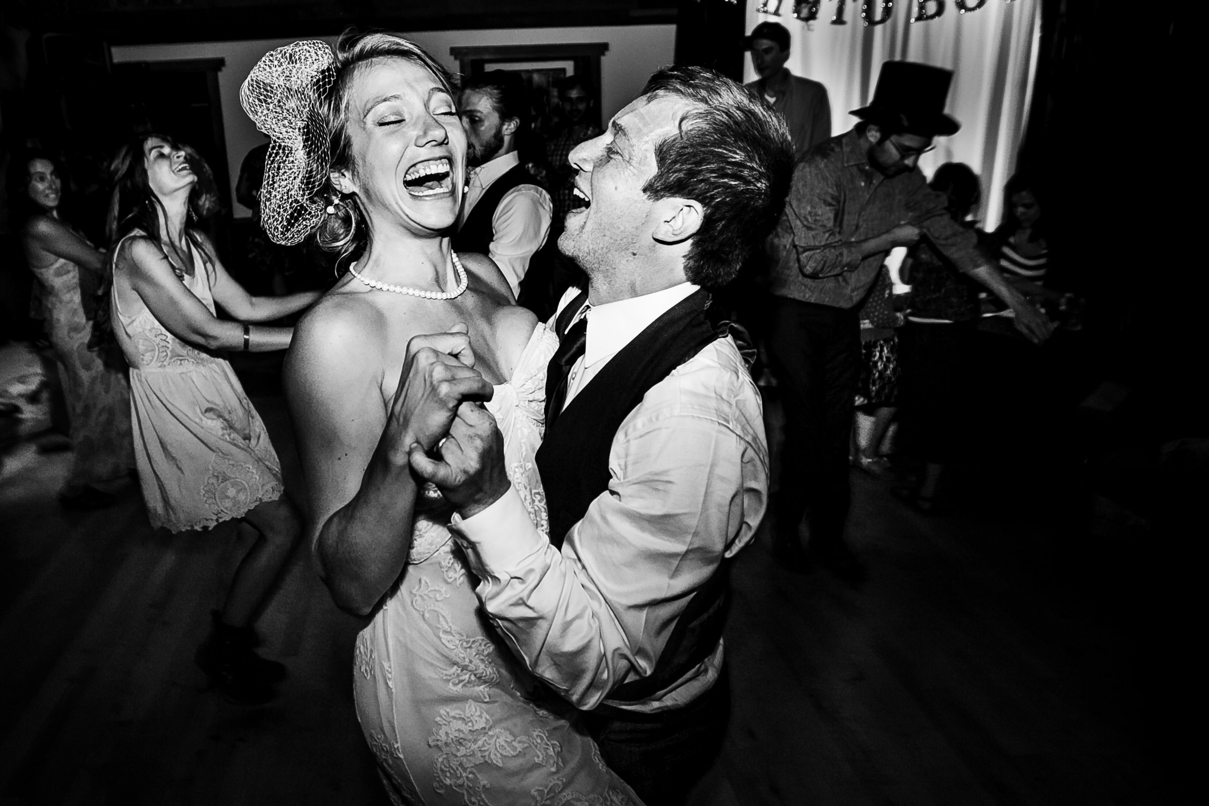 A happy bride and groom dancing during their Humboldt California wedding reception at Beginnings Briceland