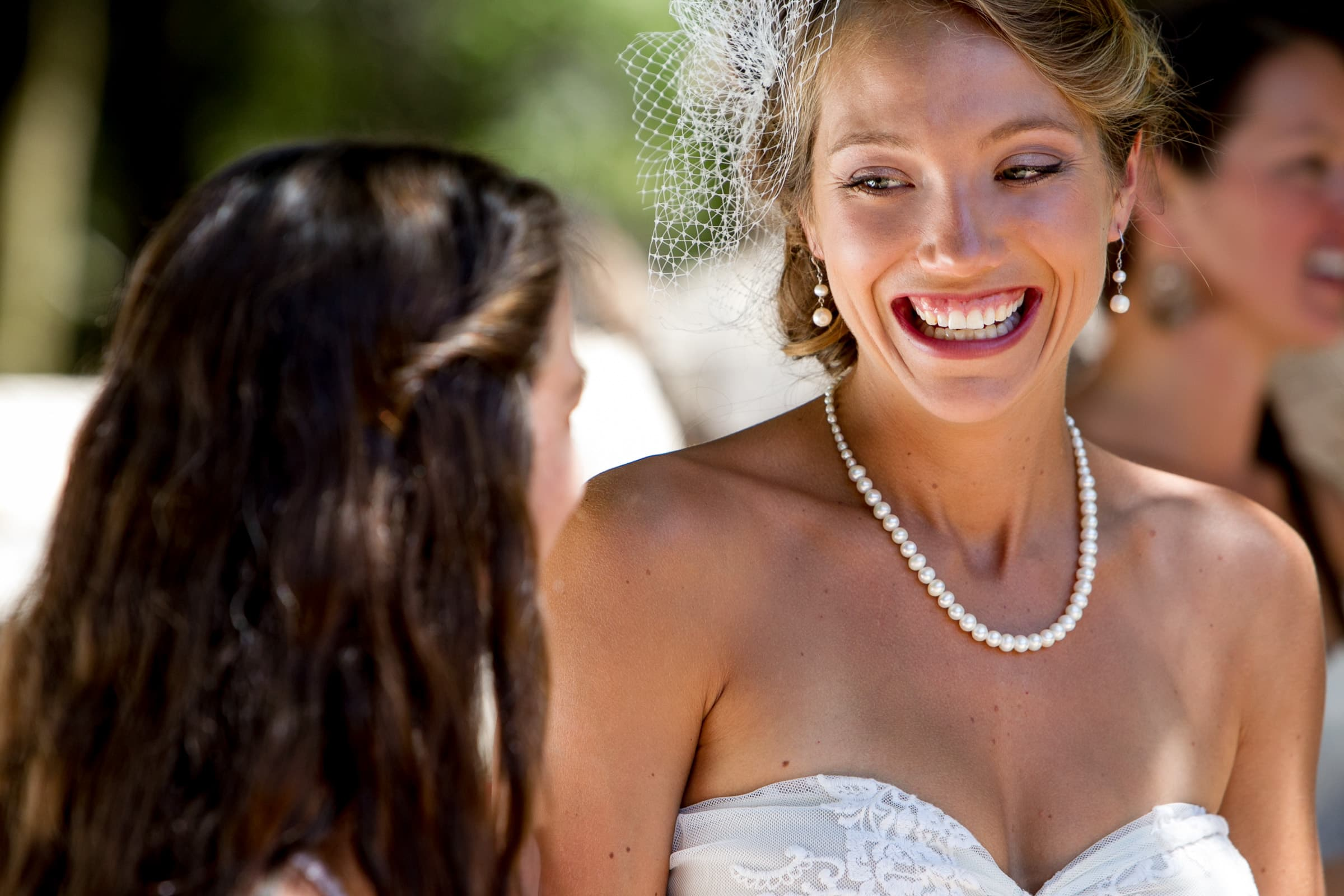 A happy bride laughing with friends moments before her Humboldt California wedding at Beginnings Briceland