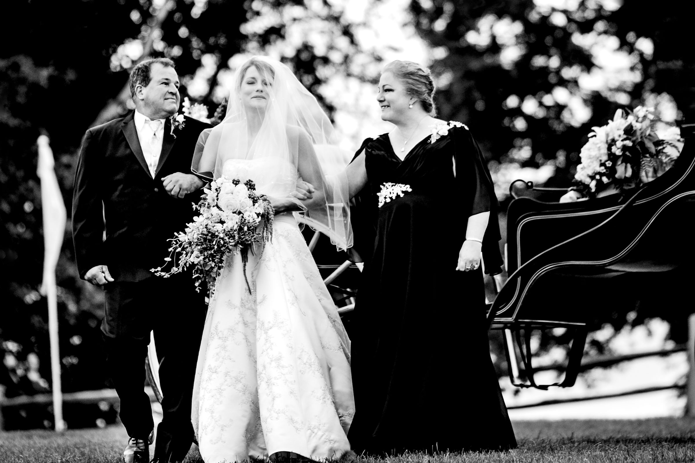 Emotional bride walking with her emotional parents into her Trapp Family Lodge wedding ceremony in Stowe, Vermont.