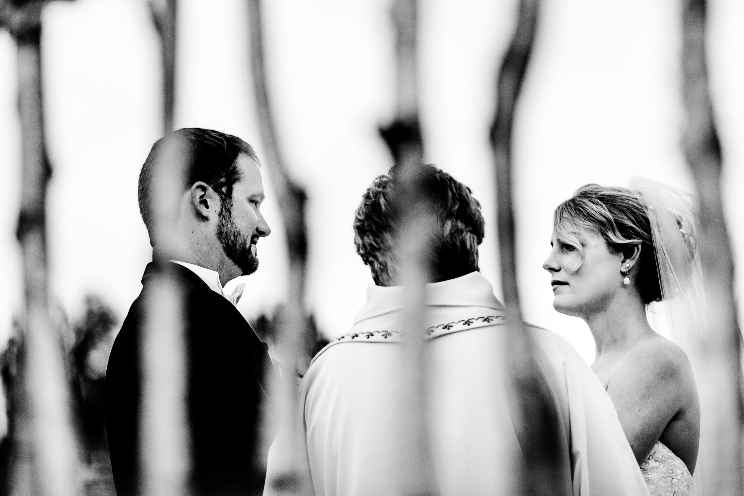 Abstract photo of a bride and groom exchanging vows during their Trapp Family Lodge wedding ceremony in Stowe, Vermont.
