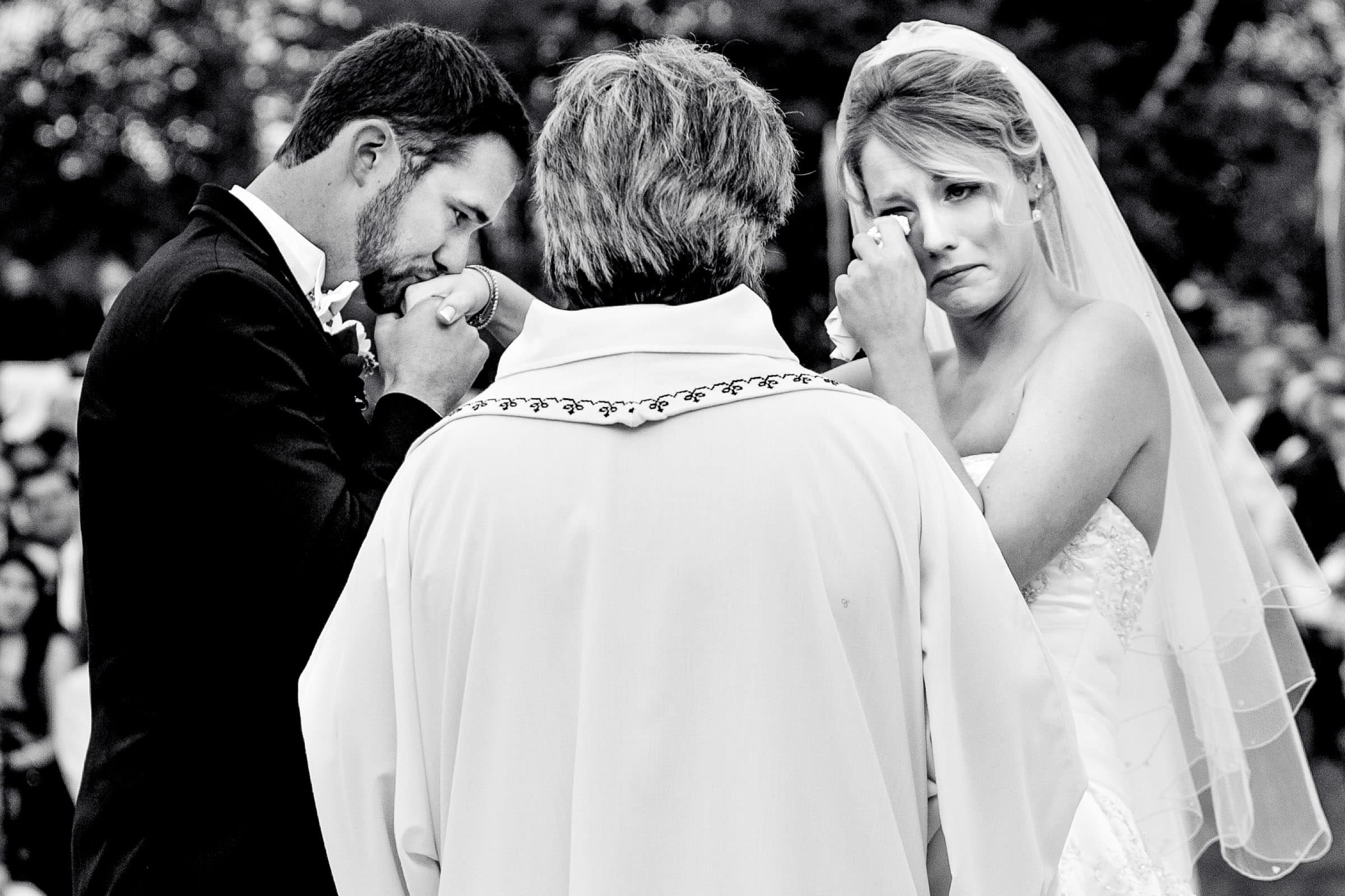 Emotional photo of a bride and groom exchanging vows during their Trapp Family Lodge wedding ceremony in Stowe, Vermont.