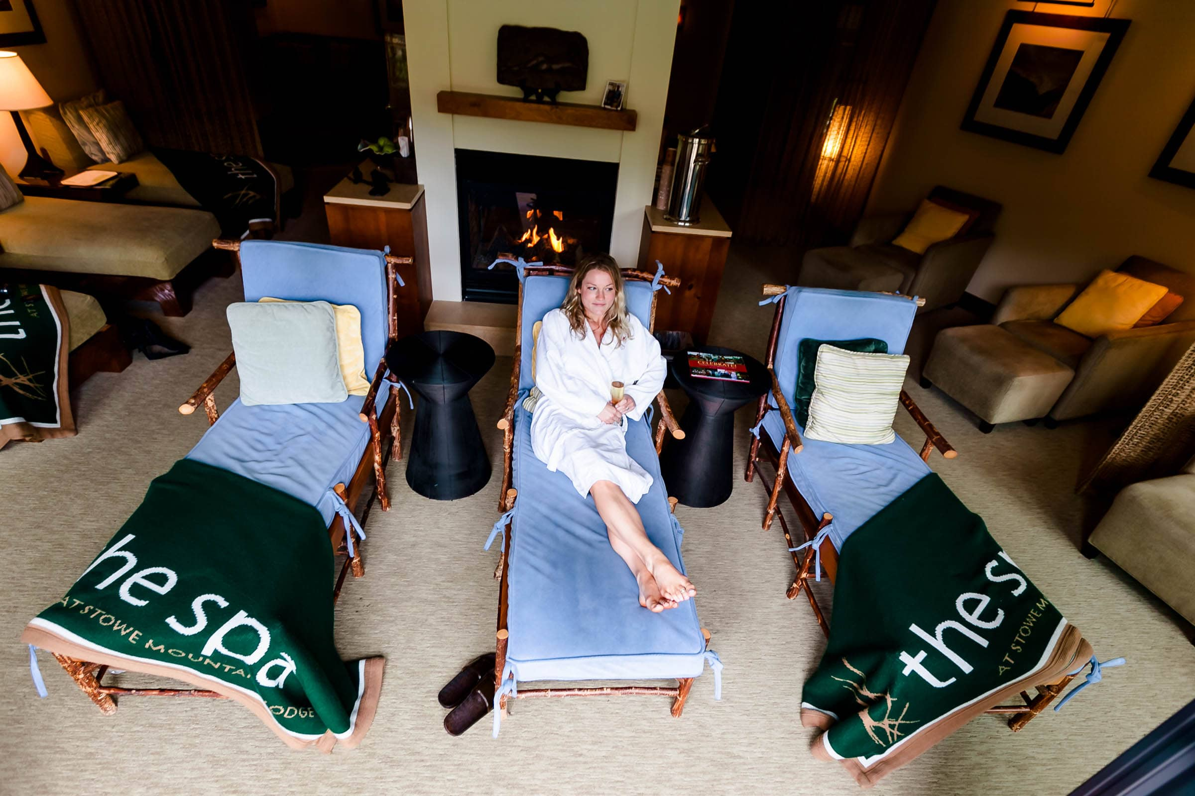 Wide angle view of a bride relaxing while getting ready for her Trapp Family Lodge wedding in Stowe, Vermont.