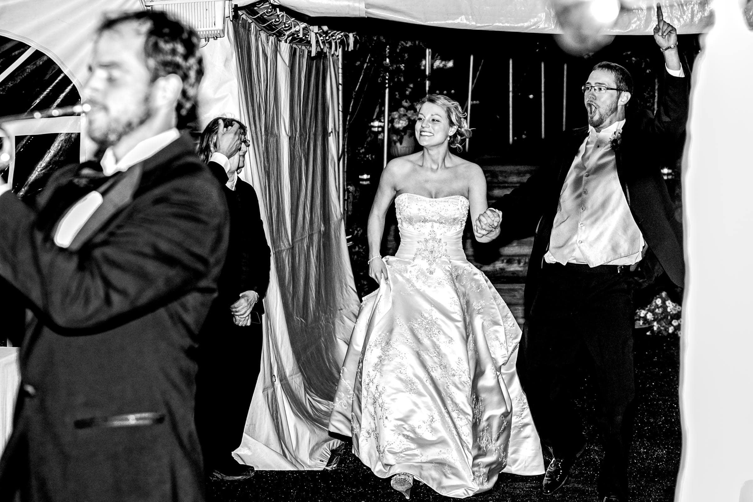 A bride and groom excited while entering their Trapp Family Lodge wedding reception in Stowe, Vermont.