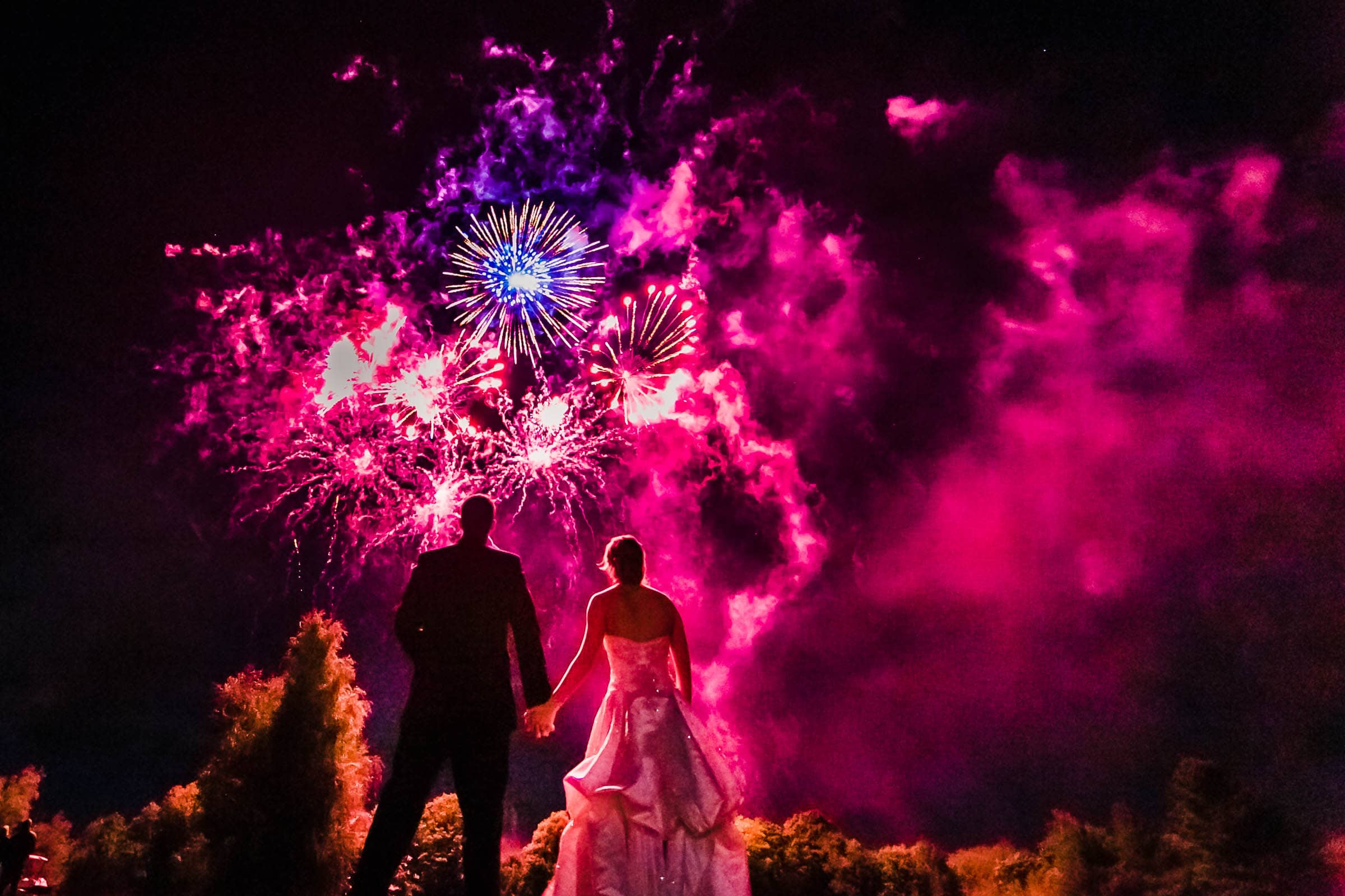 Bride and groom enjoying a massive firework display during their Trapp Family Lodge wedding reception in Stowe, Vermont.