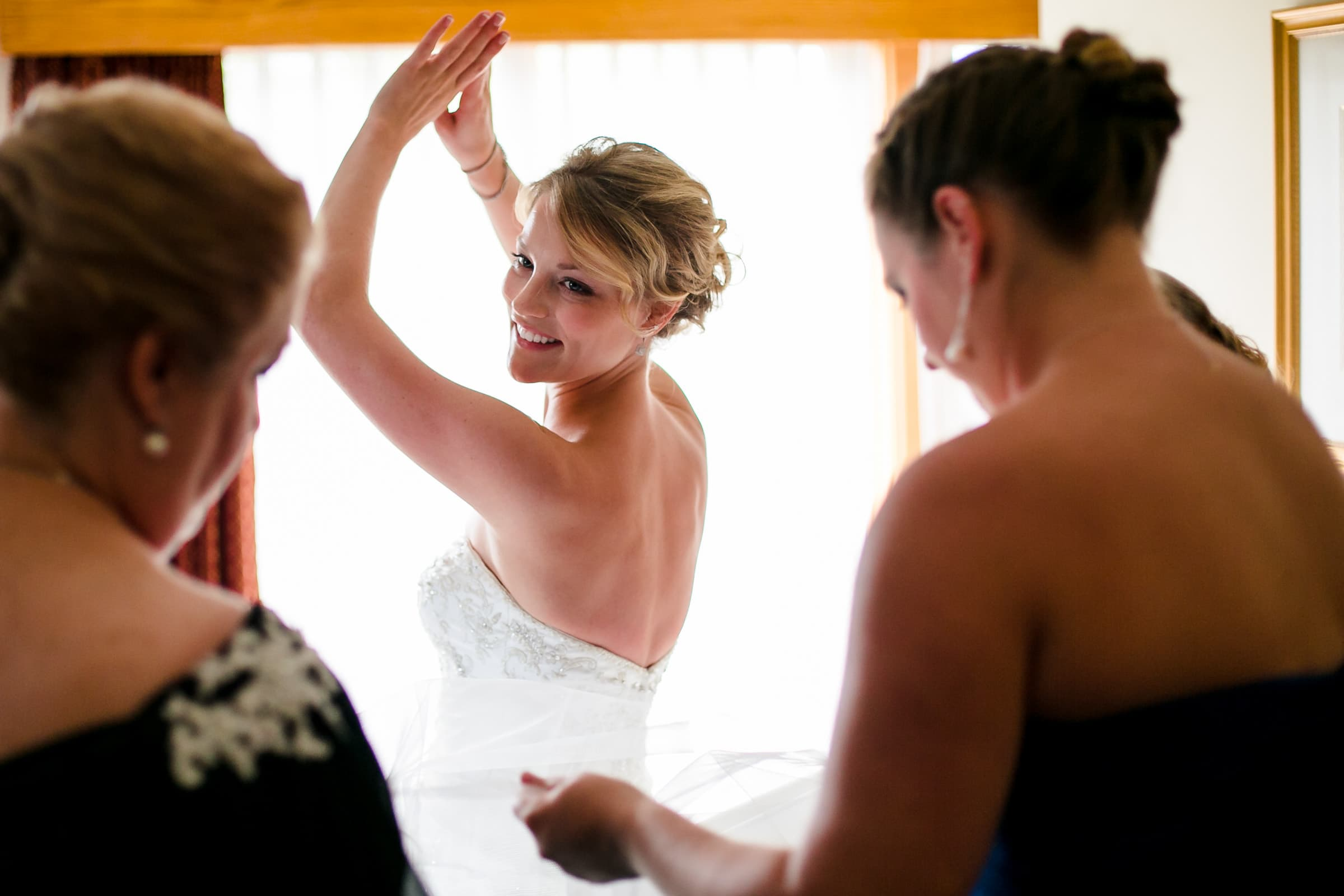 Bride getting ready with mother and best friend for her Trapp Family Lodge wedding in Stowe, Vermont.
