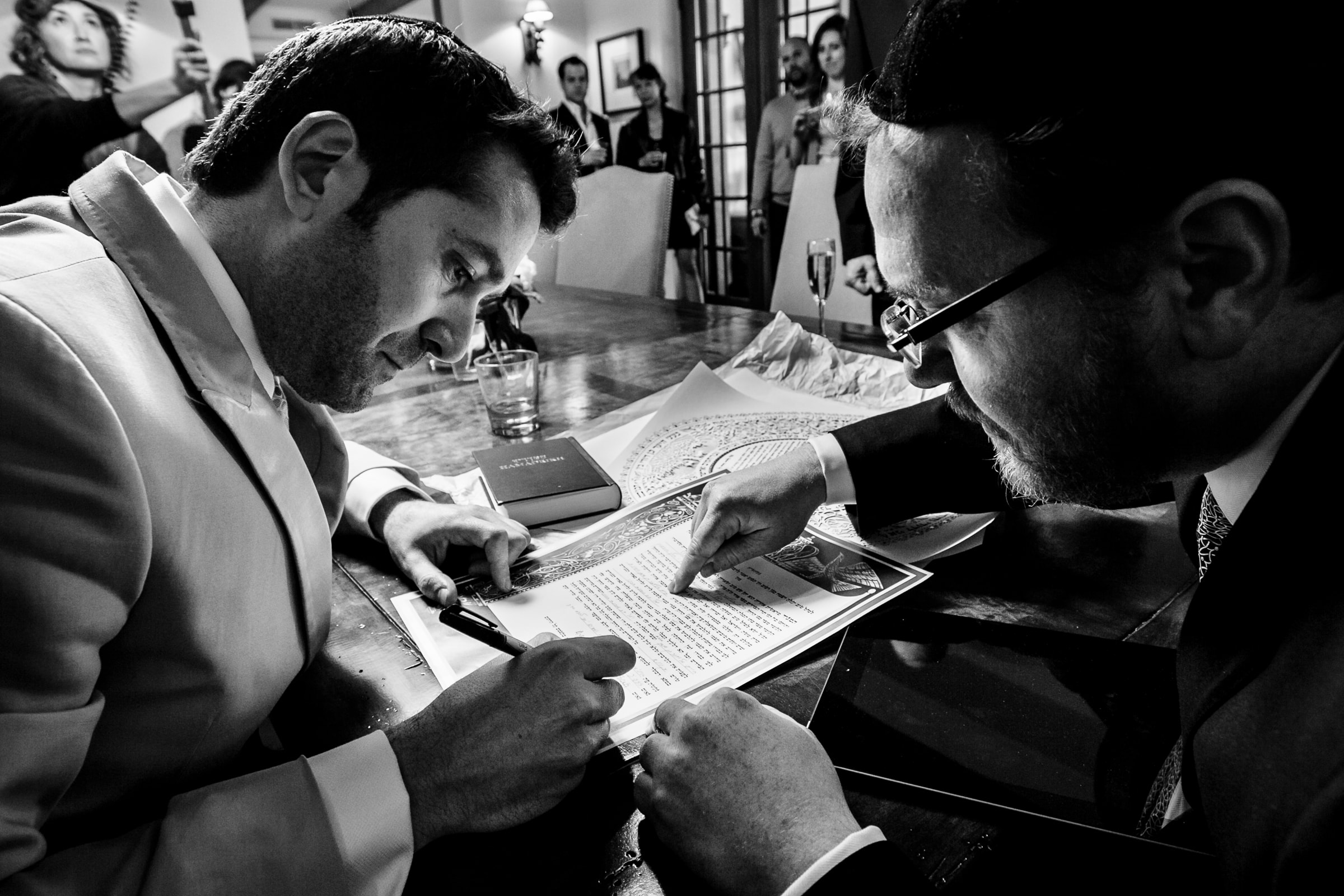 Jay Karas signing wedding certificate during his Palm Springs Wedding in California at The Bougainvillea Estate
