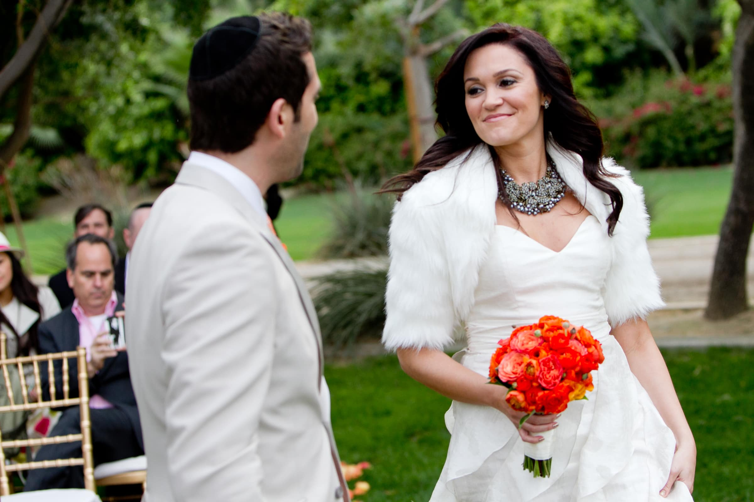 Jay Karas and Monica Osborn walking into at their Palm Springs Wedding ceremony in California at The Bougainvillea Estate