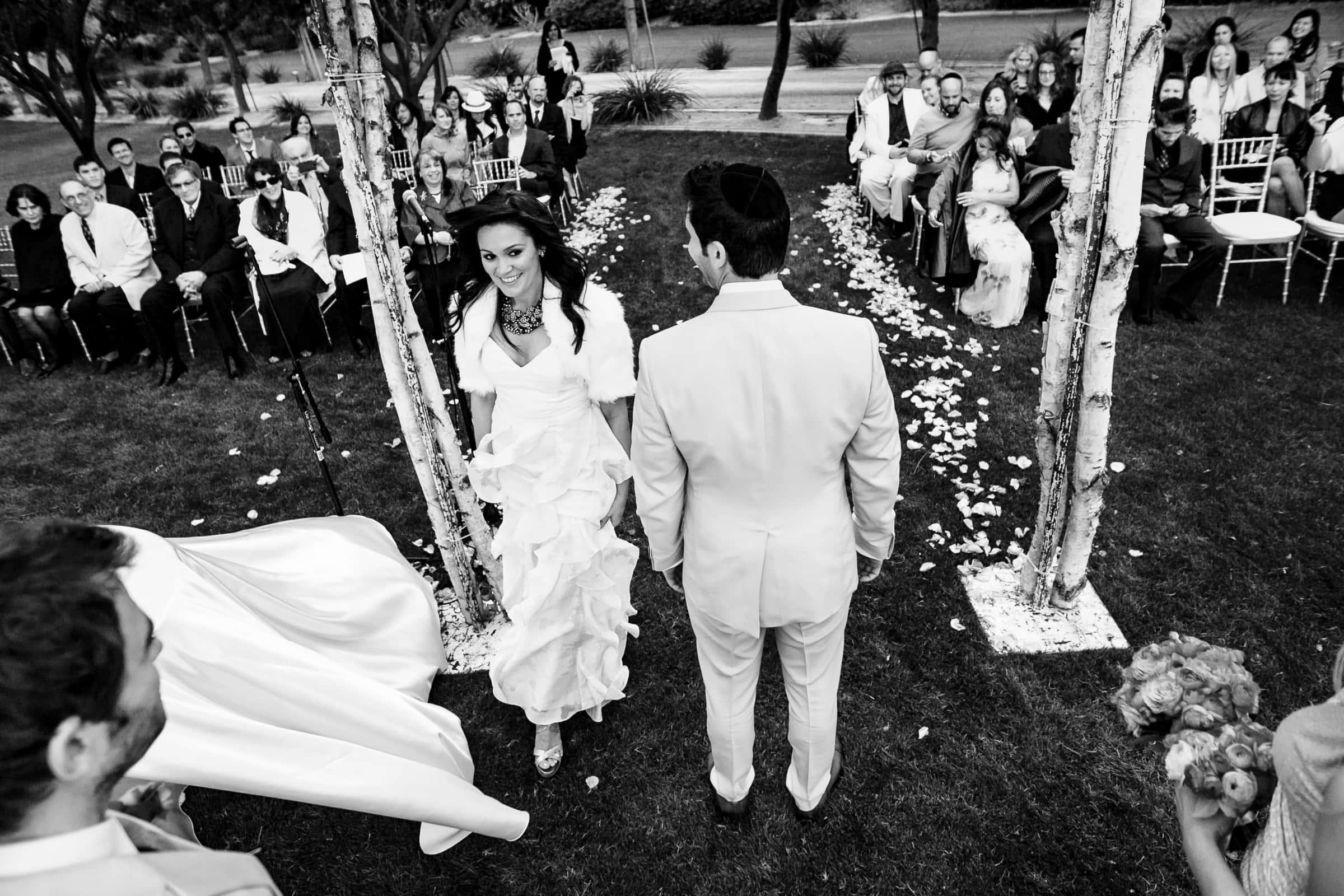 Jay Karas and Monica Osborn entering their Palm Springs Wedding in California at The Bougainvillea Estate