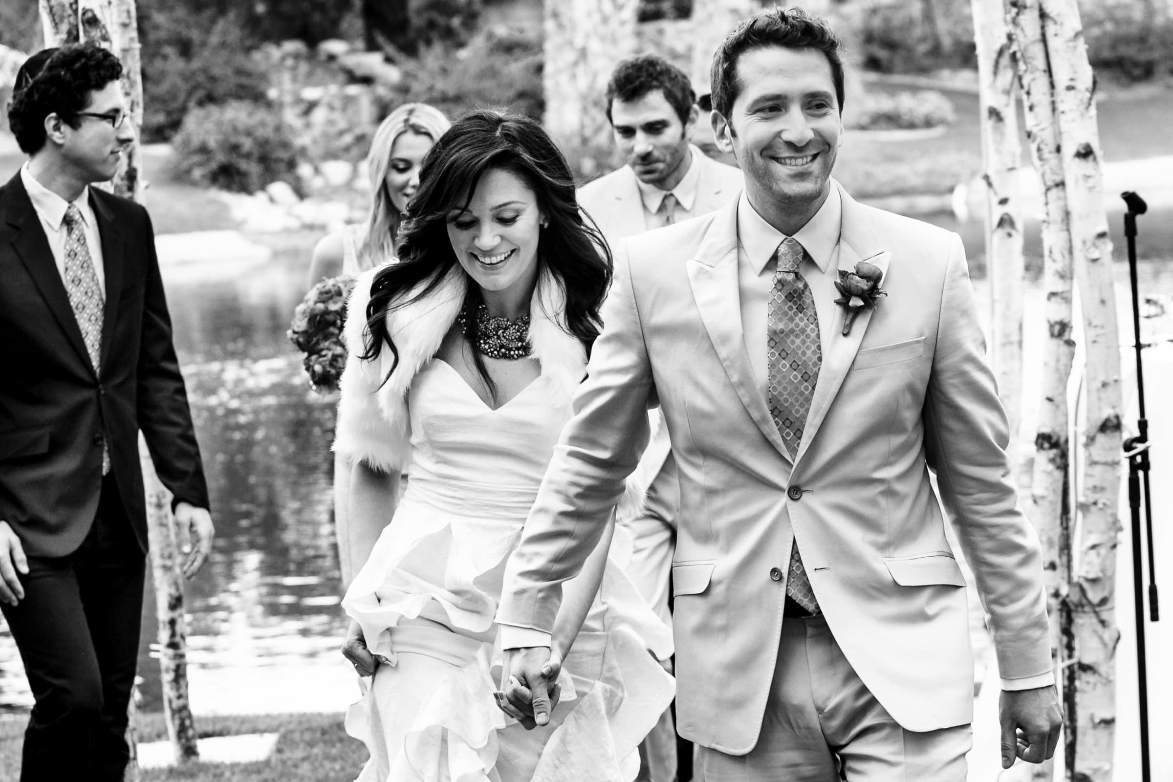 Jay Karas and Monica Osborn joyfully exiting their Palm Springs Wedding in California at The Bougainvillea Estate