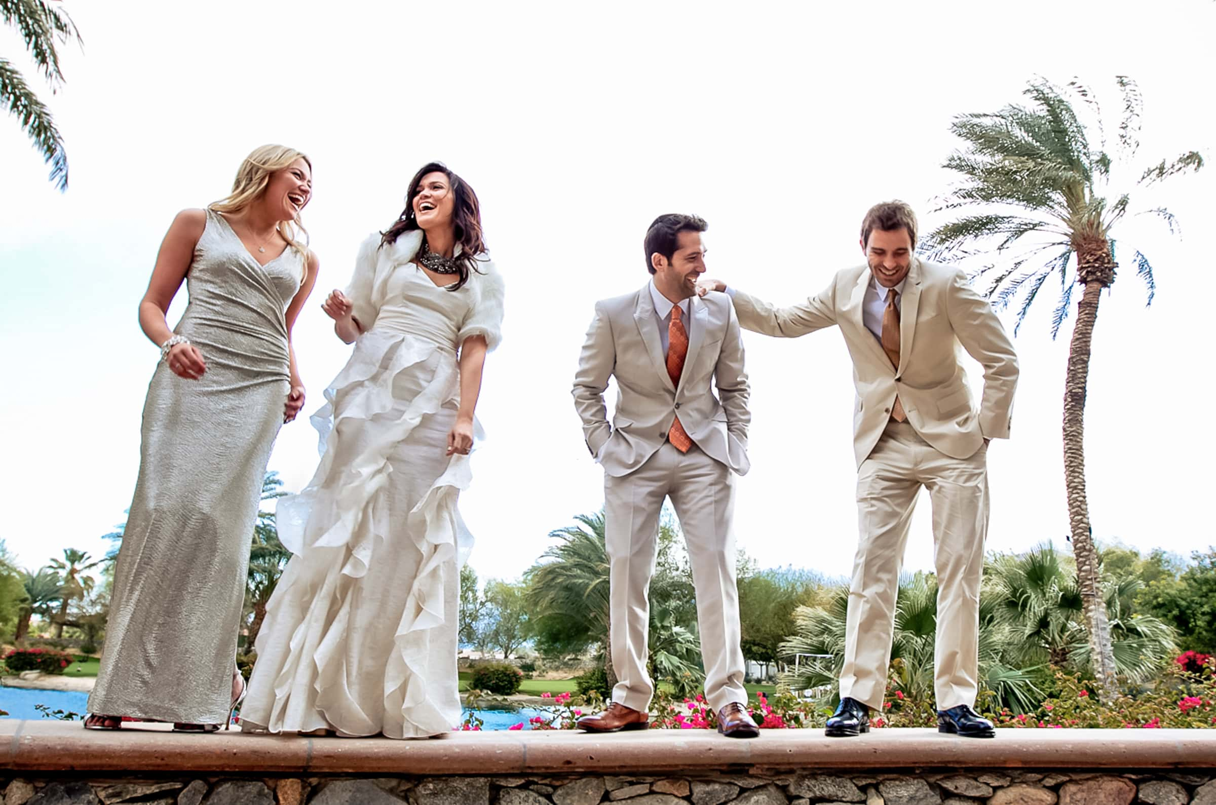 Jay Karas and Monica Osborn laughing with family and friends at their Palm Springs Wedding in California at The Bougainvillea Estate