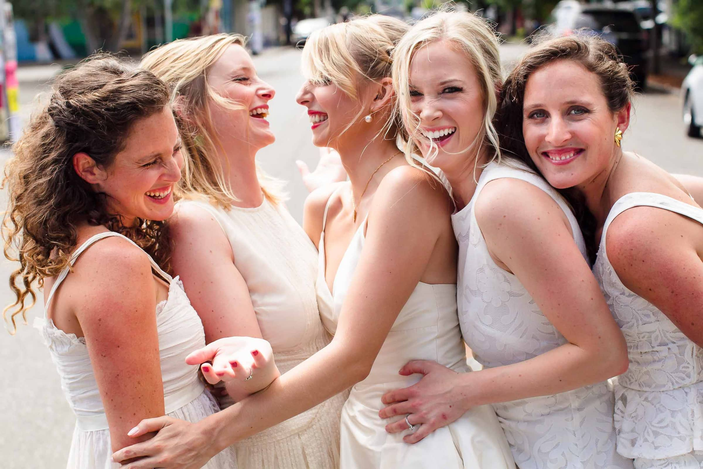 A fun photo of bridesmaids laughing together just outside Jupiter Hotel before heading out to their camp angleos wedding
