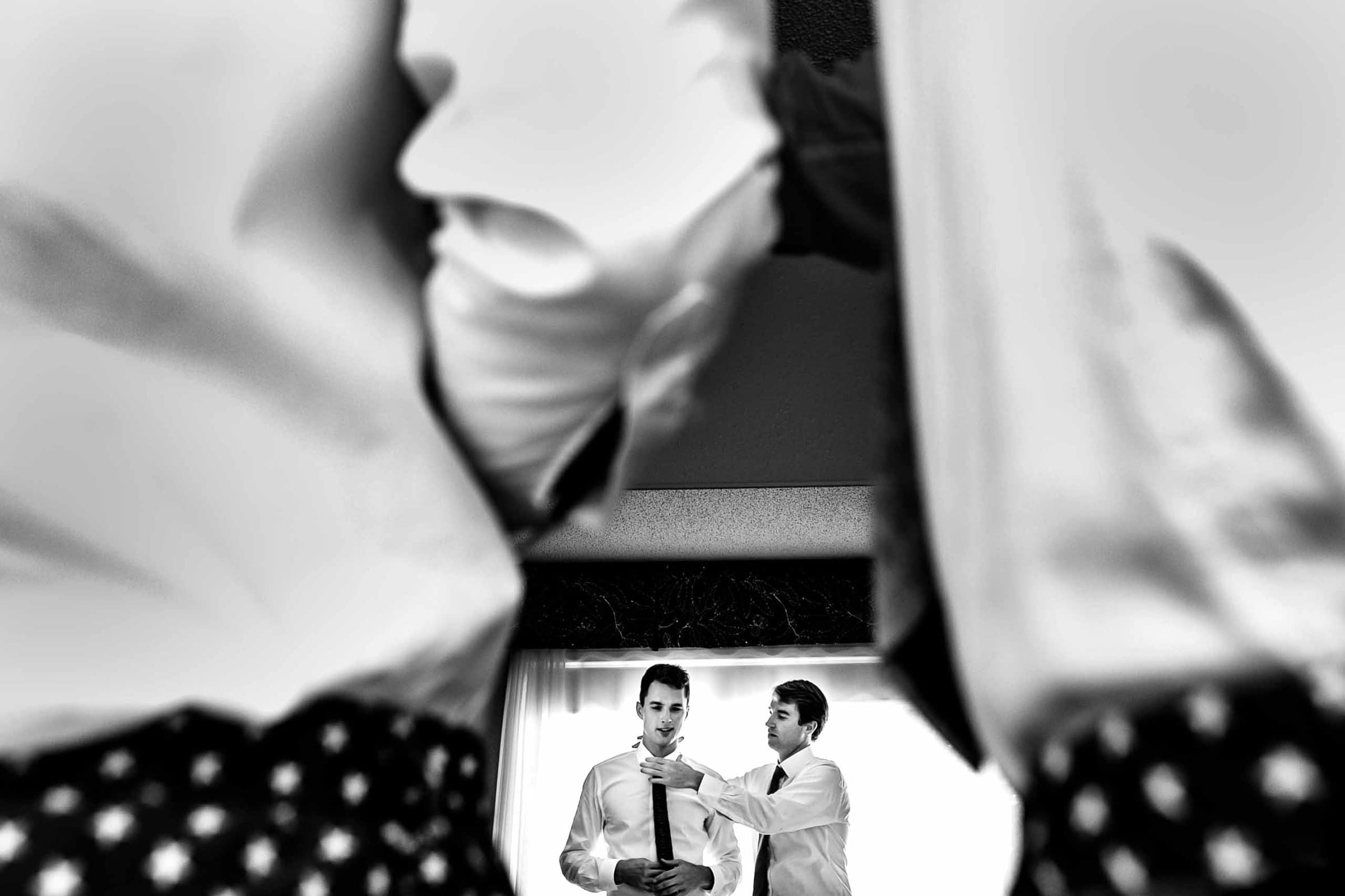 creative photo of a groom getting ready with friends at Jupiter Hotel in Portland before heading to their camp angleos wedding photographed by jos and tree and wedding coordination by luxe event productions