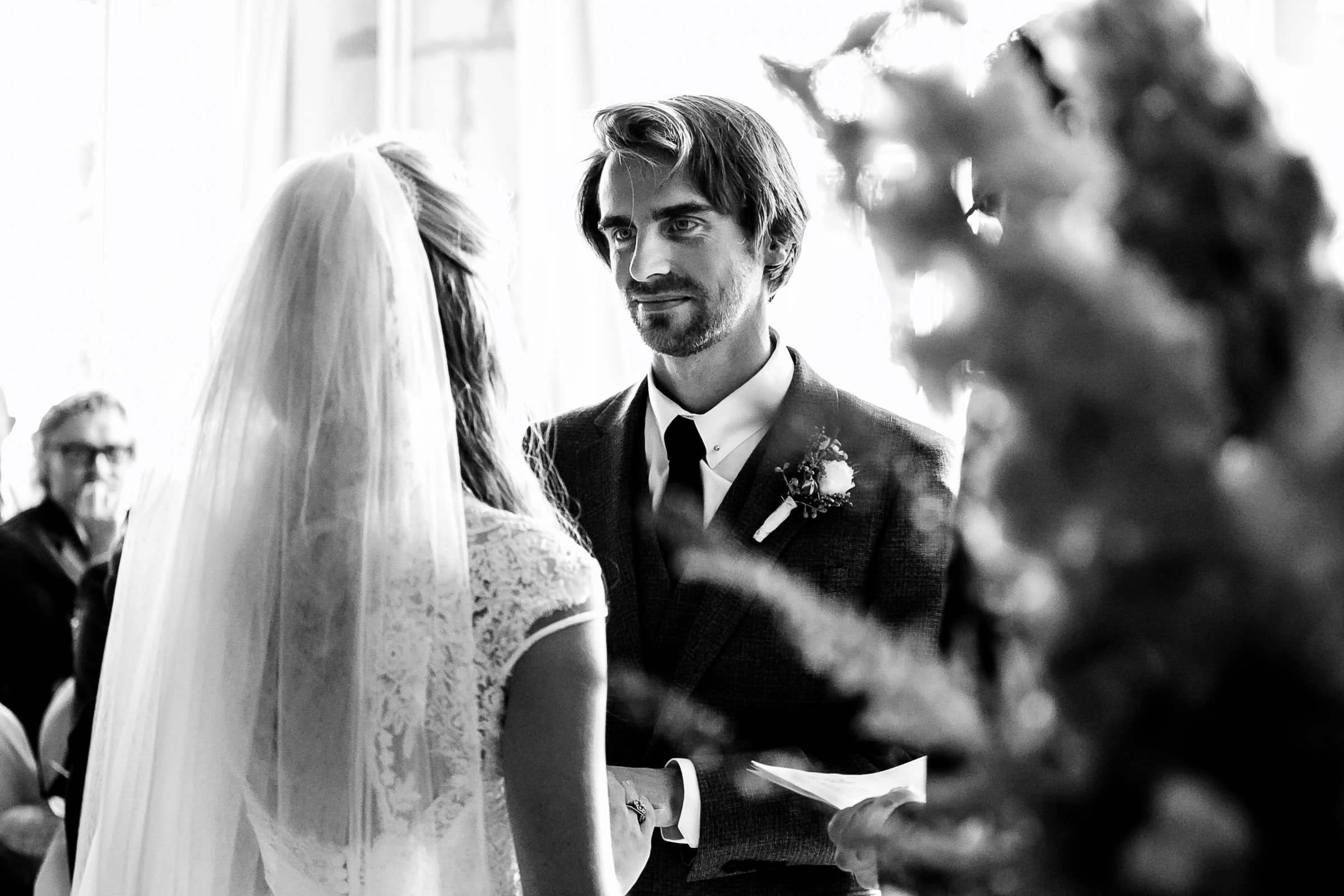 Groom exchanging vows during a French Chateau wedding in Normandy, France