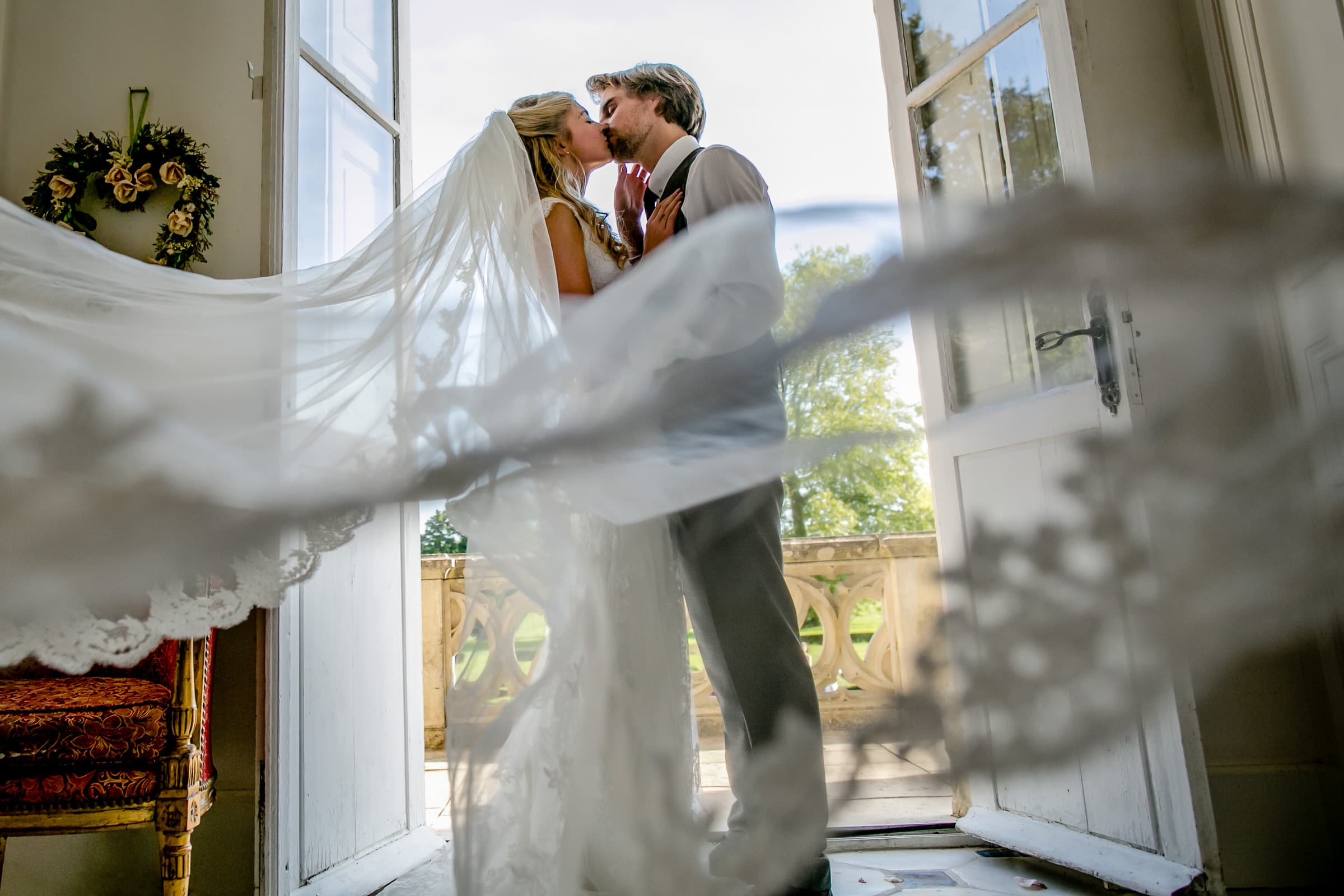 Bride and groom embracing during a French Chateau wedding in Normandy, France