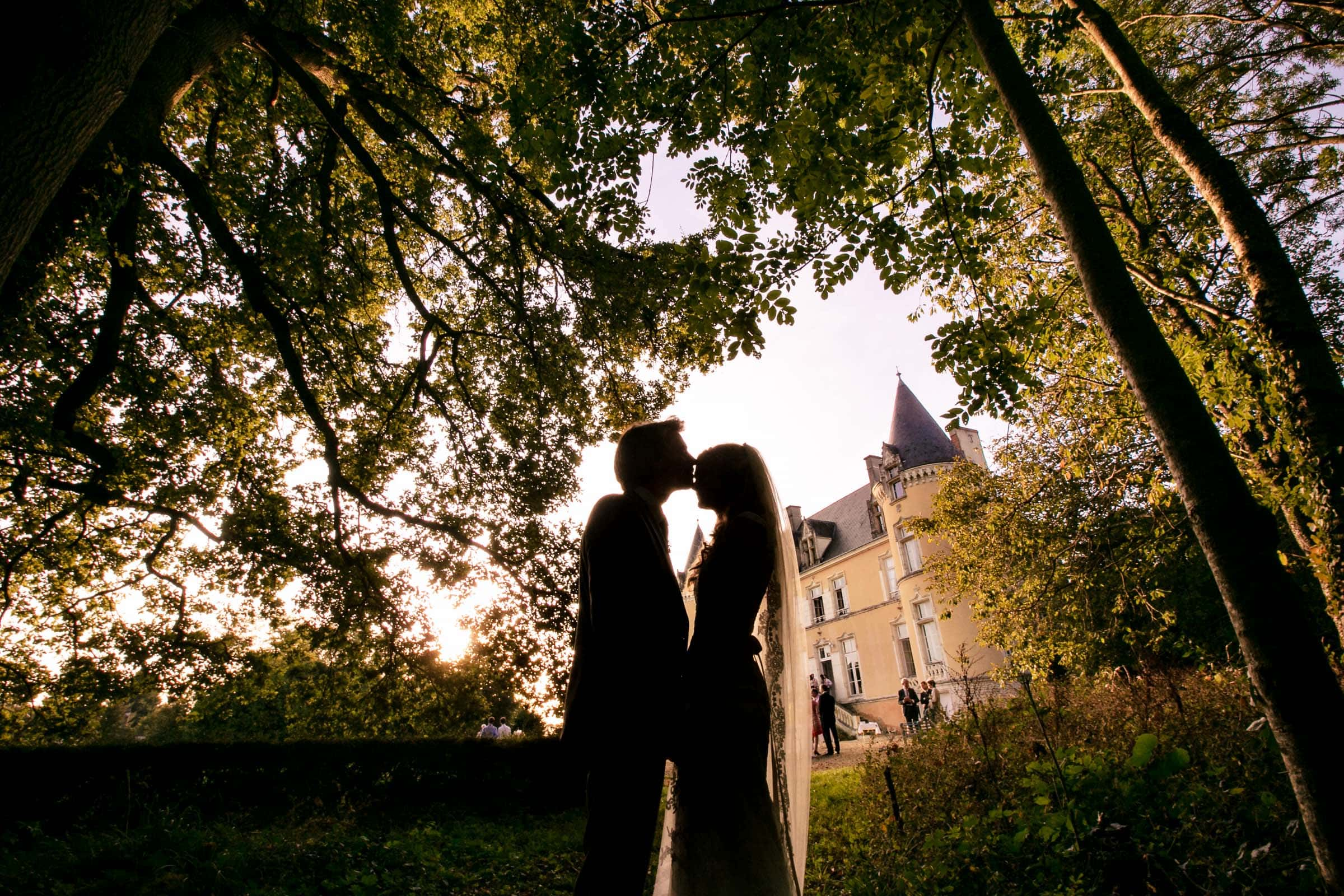 Silhouette of a bride and groom during a French Chateau wedding in Normandy, France