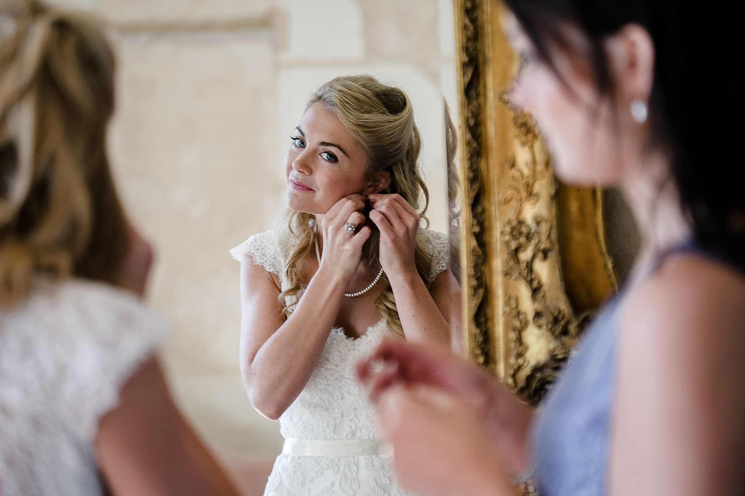 Bride getting ready for her French Chateau wedding in Normandy, France