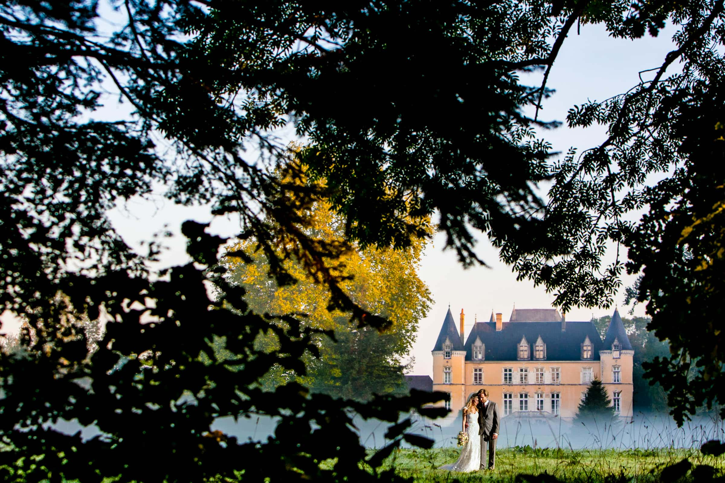 Bride and groom in golden light during their French Chateau wedding in Normandy France