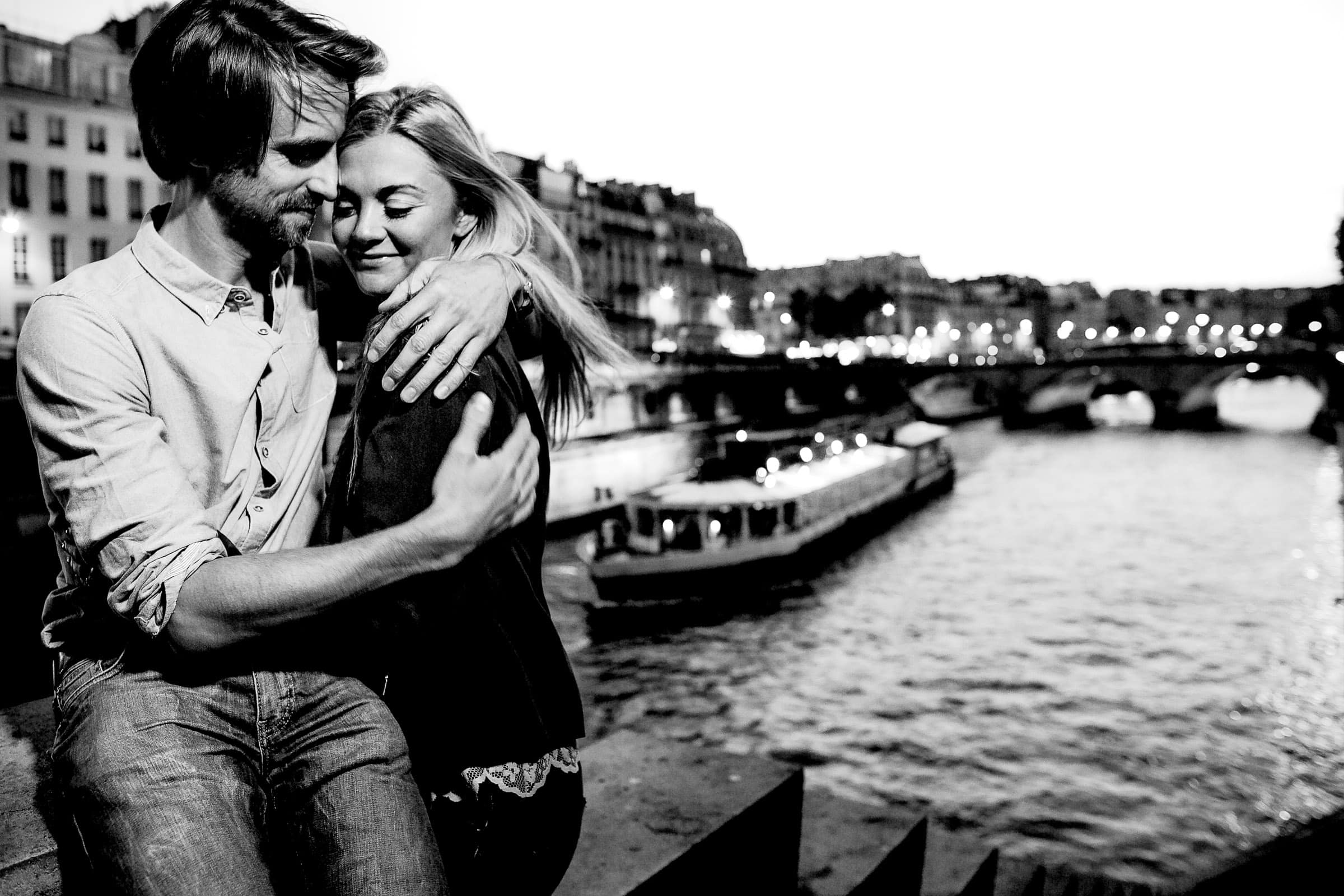 A photo of Faye and David's Montmartre Paris Engagement along the Seine River