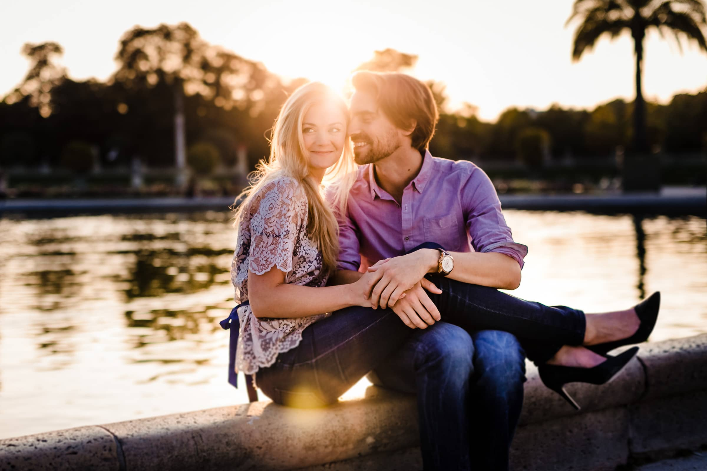 A peaceful moment of connection during Faye and David's Montmartre Paris Engagement date in the Luxembourg Gardens during warm sunset.