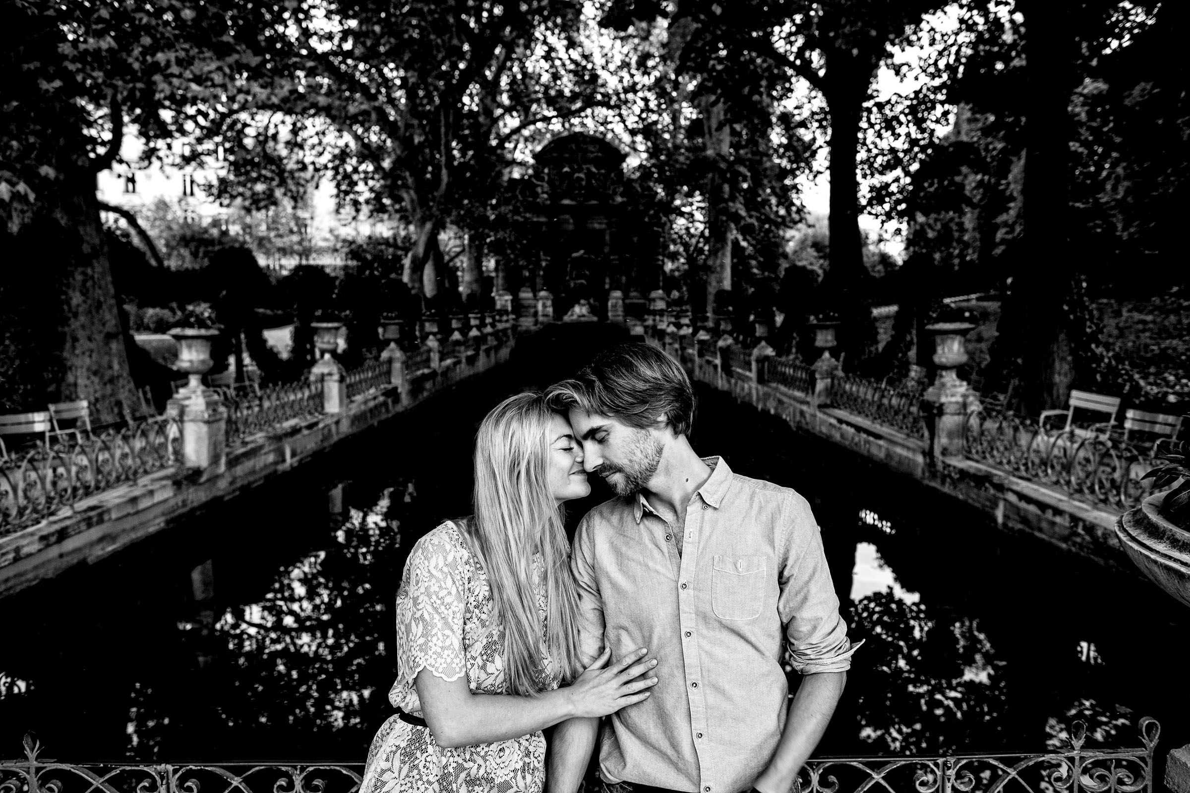 A peaceful moment of connection during Faye and David's Montmartre Paris Engagement date in the Luxembourg Gardens.