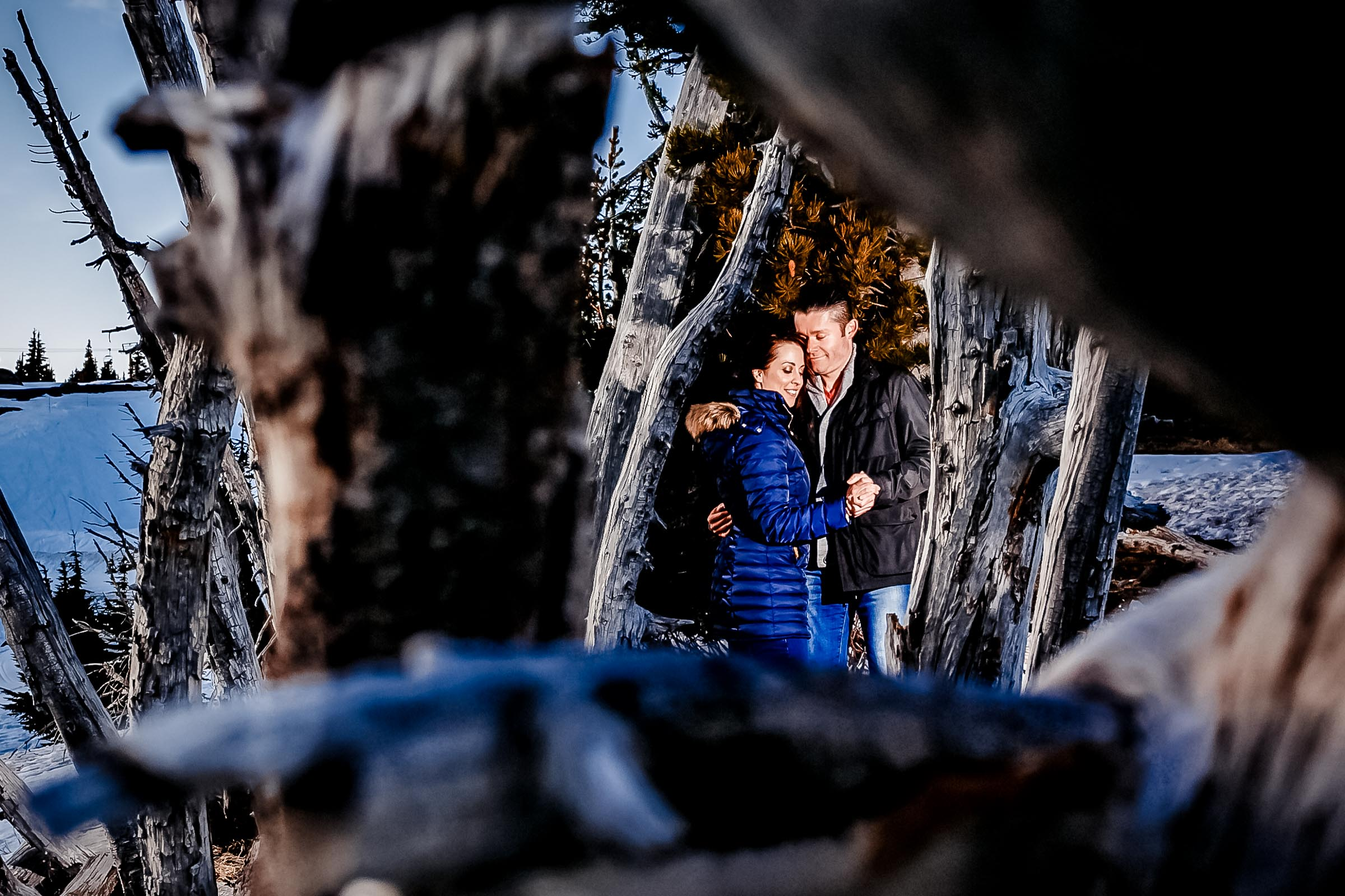 An intimate Timberline Lodge Engagement photo of a couple atop Mt Hood