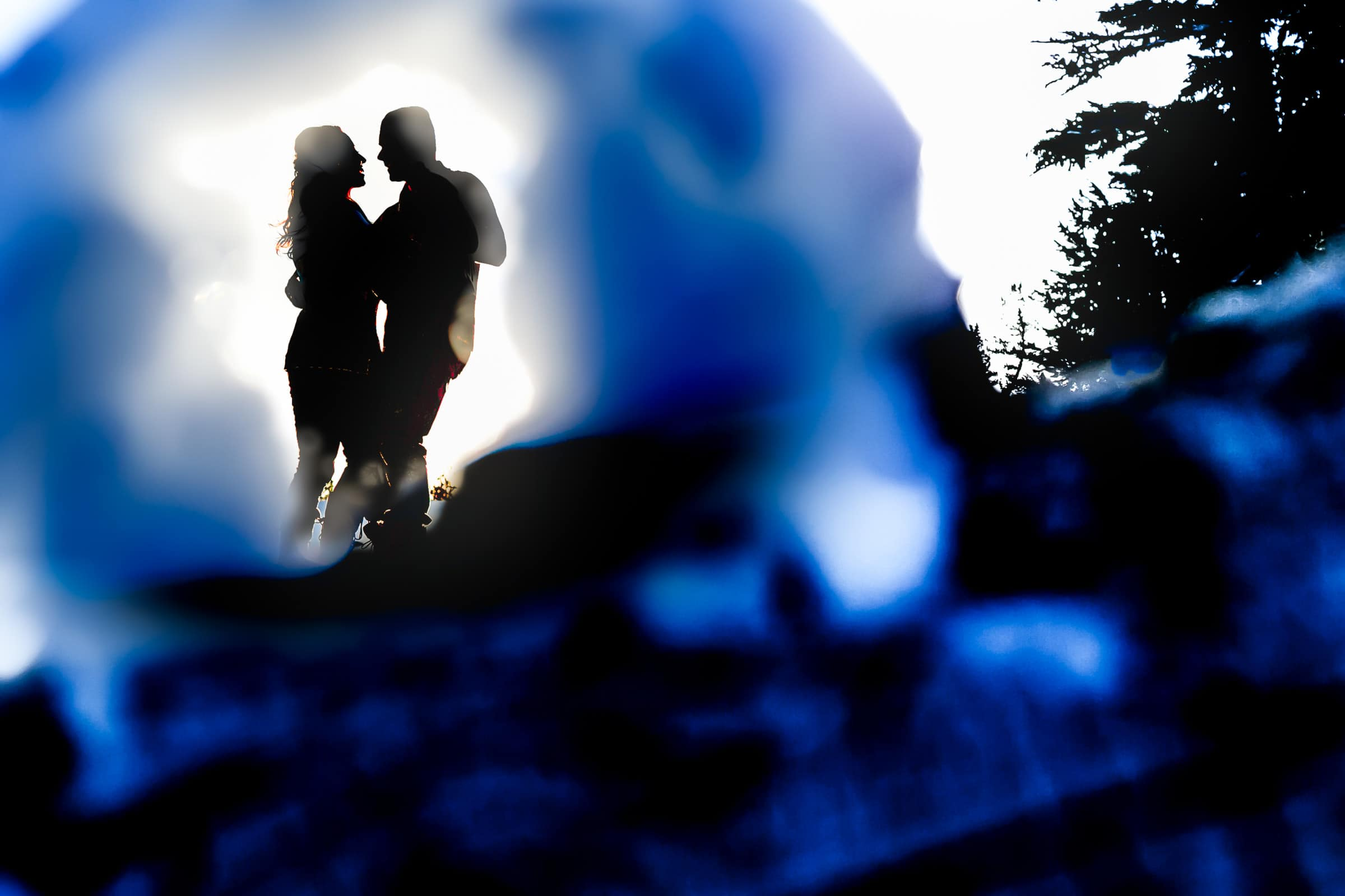 A unique and creative Timberline Lodge Engagement silhouette photo of a couple atop Mt Hood
