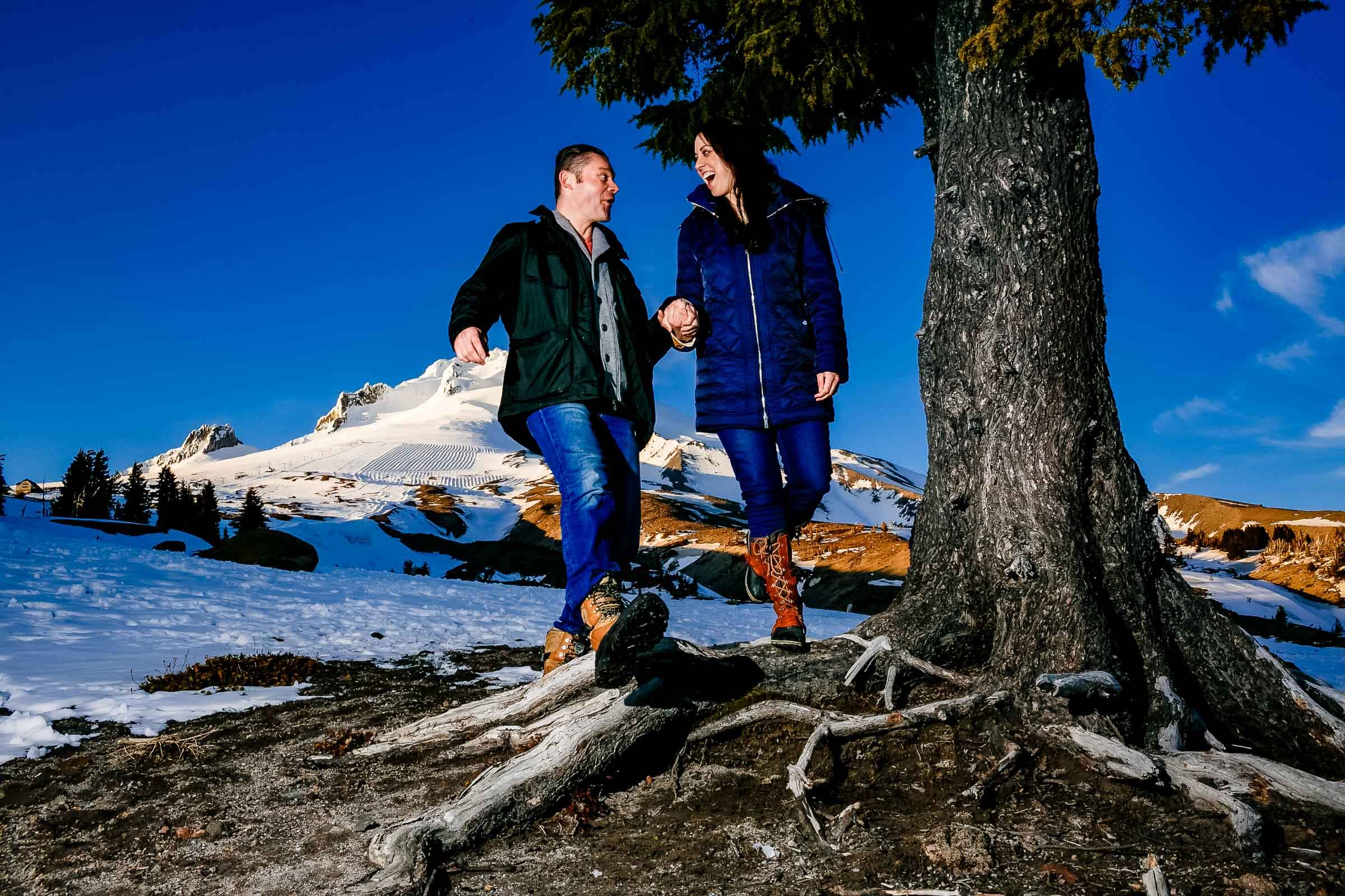 A fun Timberline Lodge Engagement photo of a couple atop Mt Hood