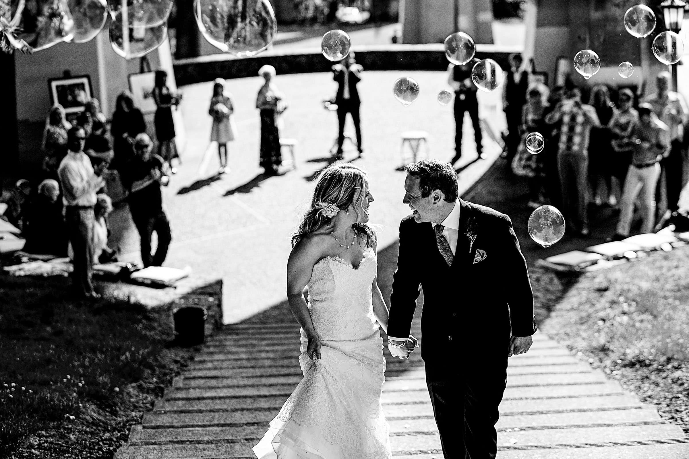 Bride and Groom exiting their outdoor small Cathedral Park Wedding ceremony with bubbles Portland Oregon