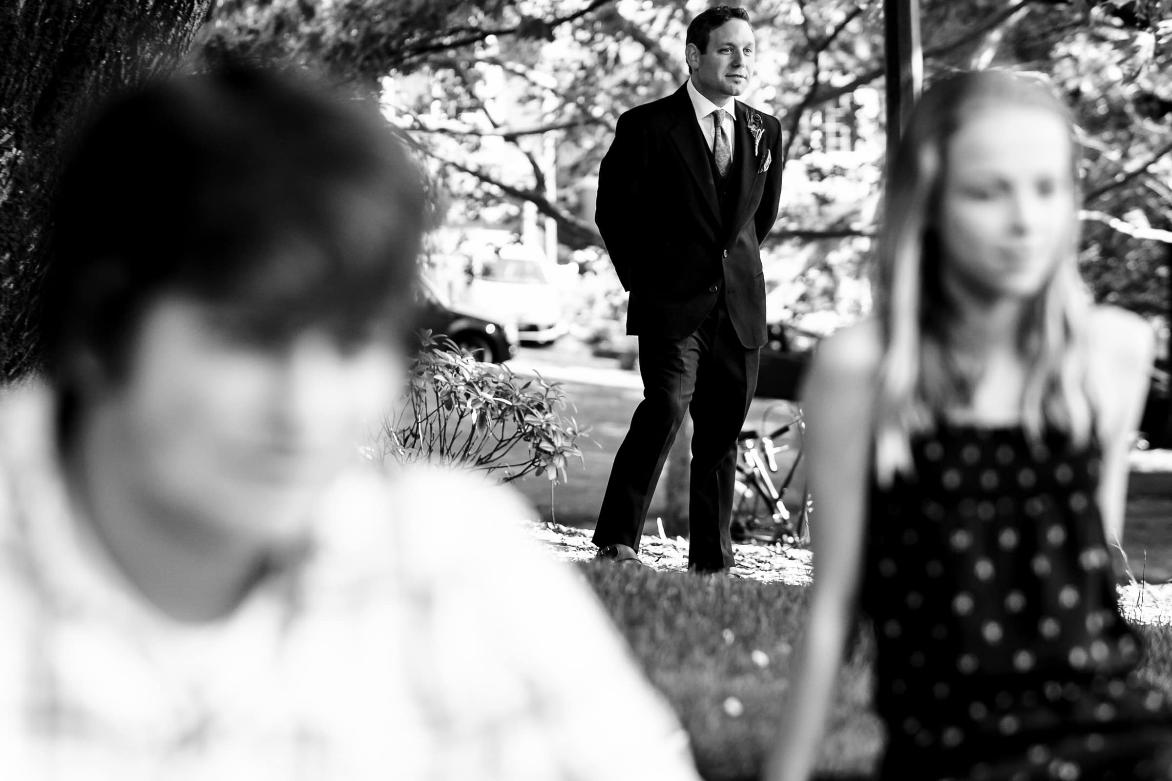 Groom waiting to walk into an outdoor small Cathedral Park Wedding ceremony in Portland Oregon