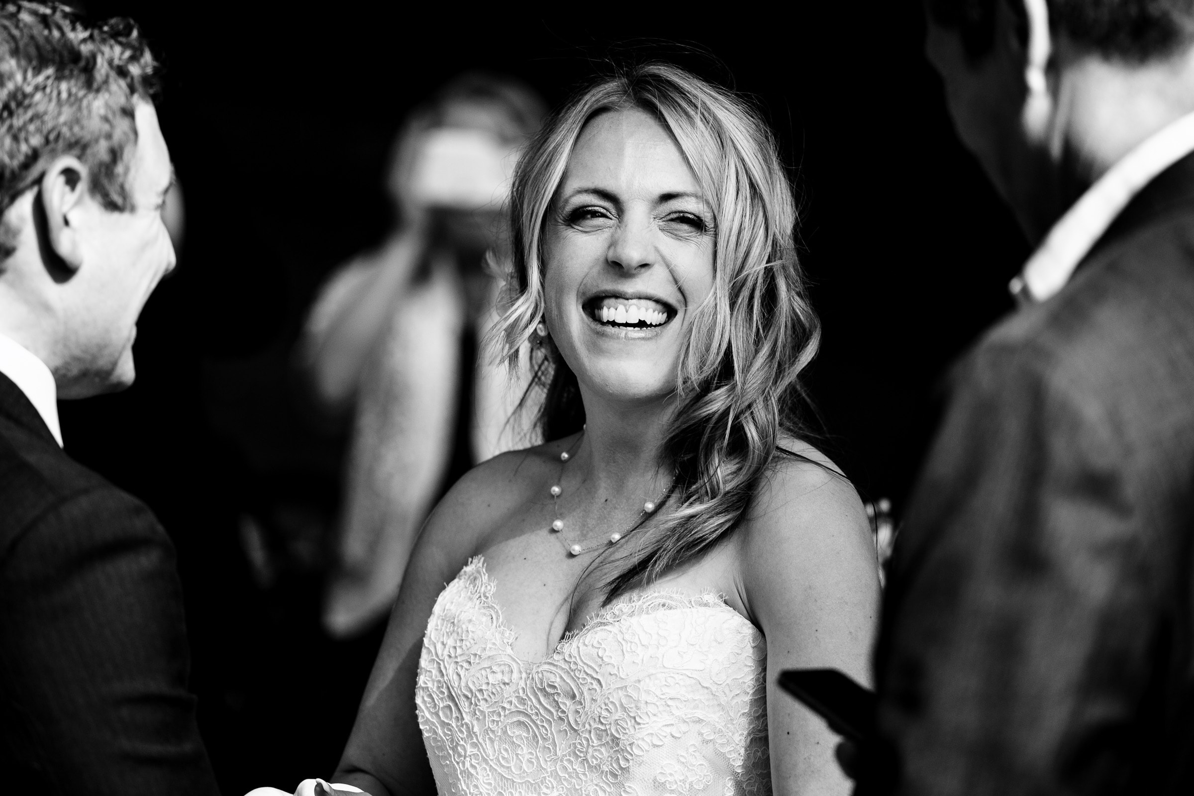 bride laughing during their outdoor small Cathedral Park Wedding ceremony in Portland Oregon