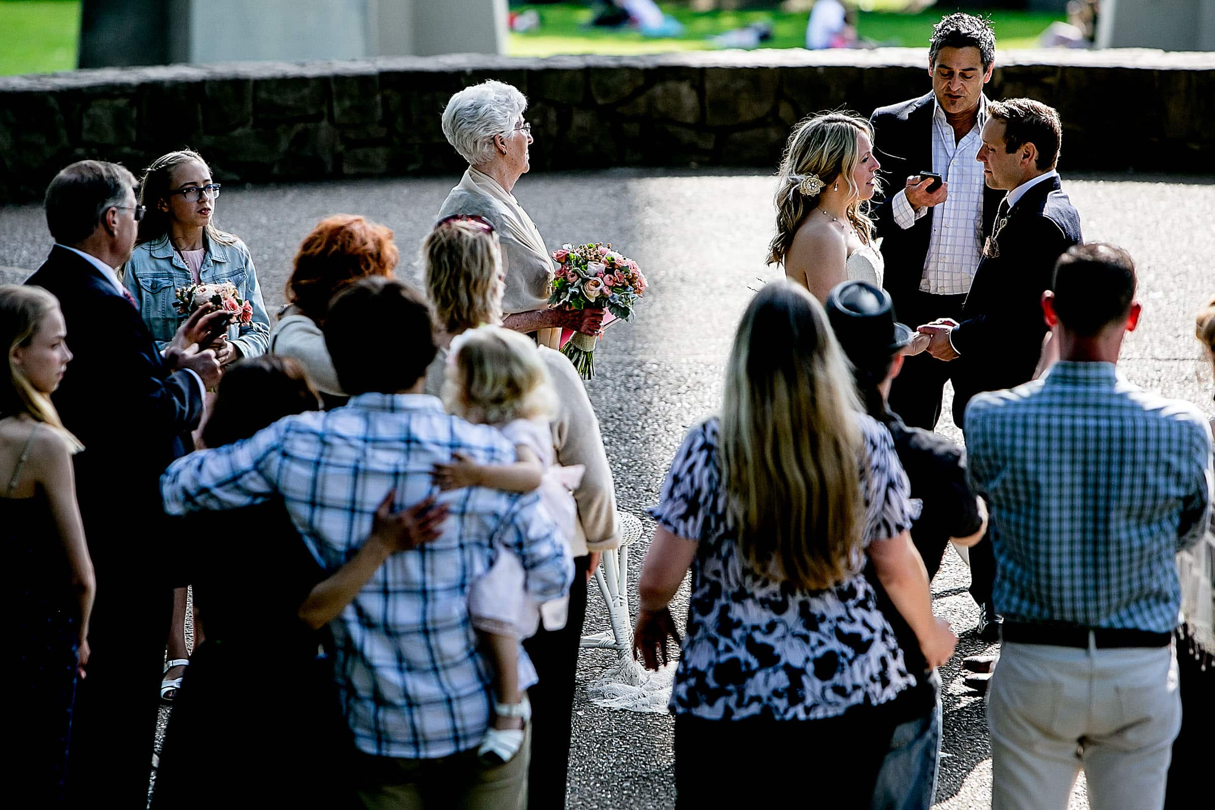 Bride and groom exchanging vows their outdoor small Cathedral Park Wedding ceremony in Portland Oregon