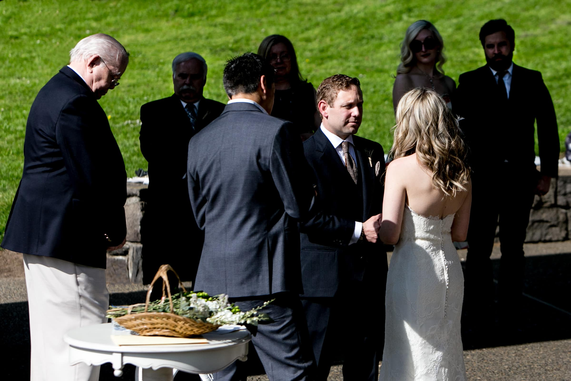 Bride and groom exchanging vows during an outdoor small Cathedral Park Wedding ceremony in Portland Oregon