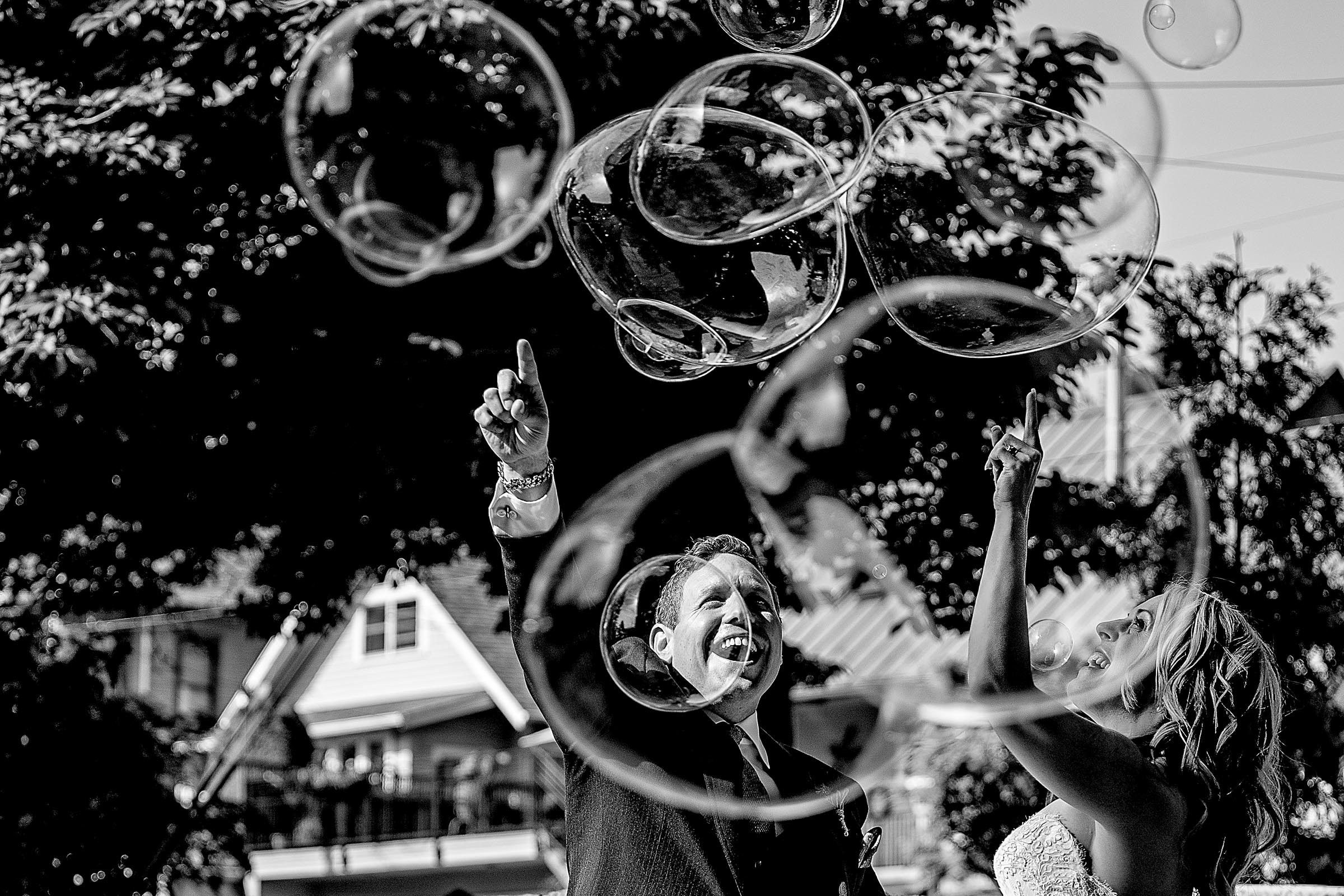 Bride and groom celebrating with joy and bubbles during their outdoor small Cathedral Park Wedding ceremony in Portland Oregon