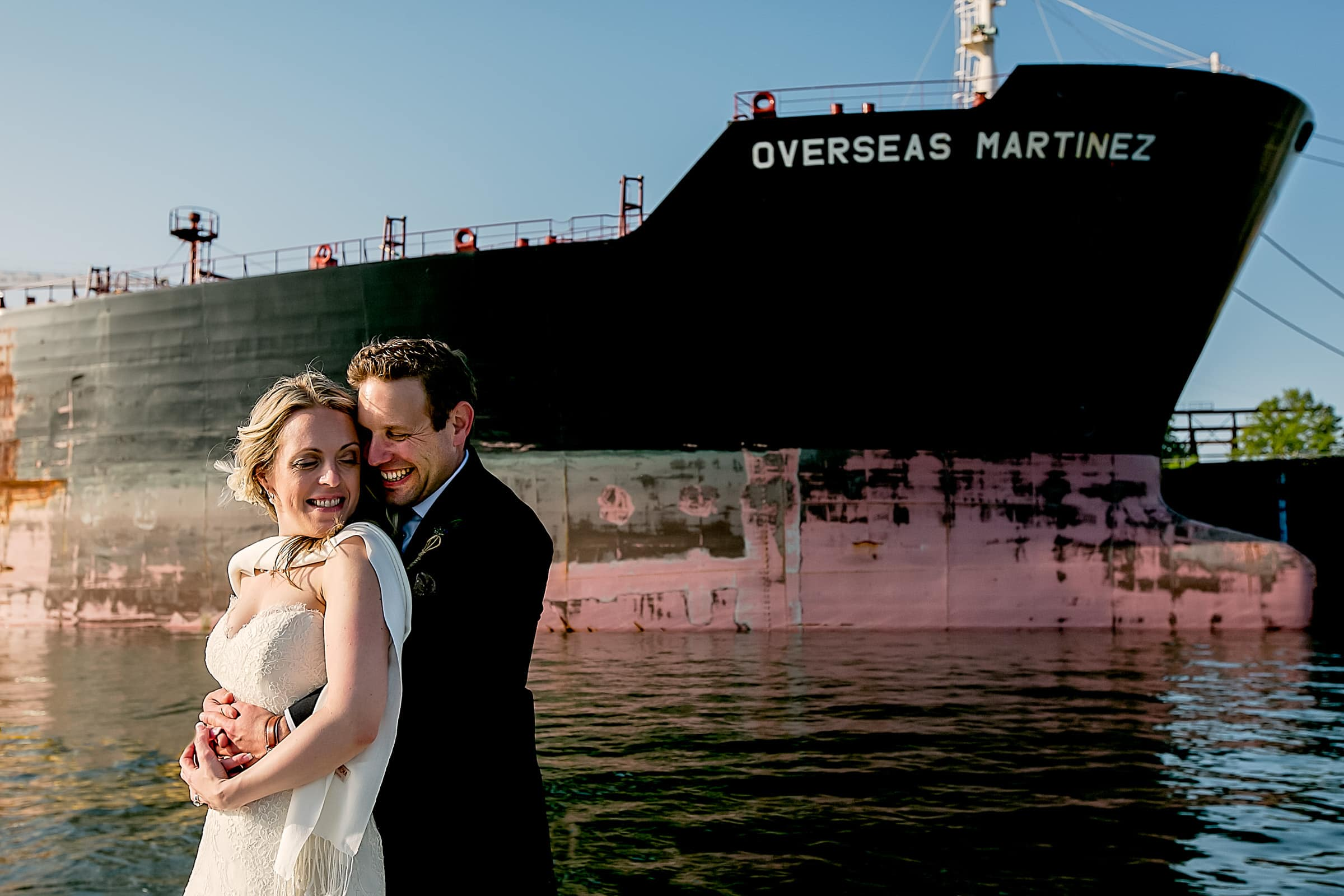 Bride and groom portrait near the Overseas Martinez ship moments after their outdoor small Cathedral Park Wedding ceremony in Portland Oregon