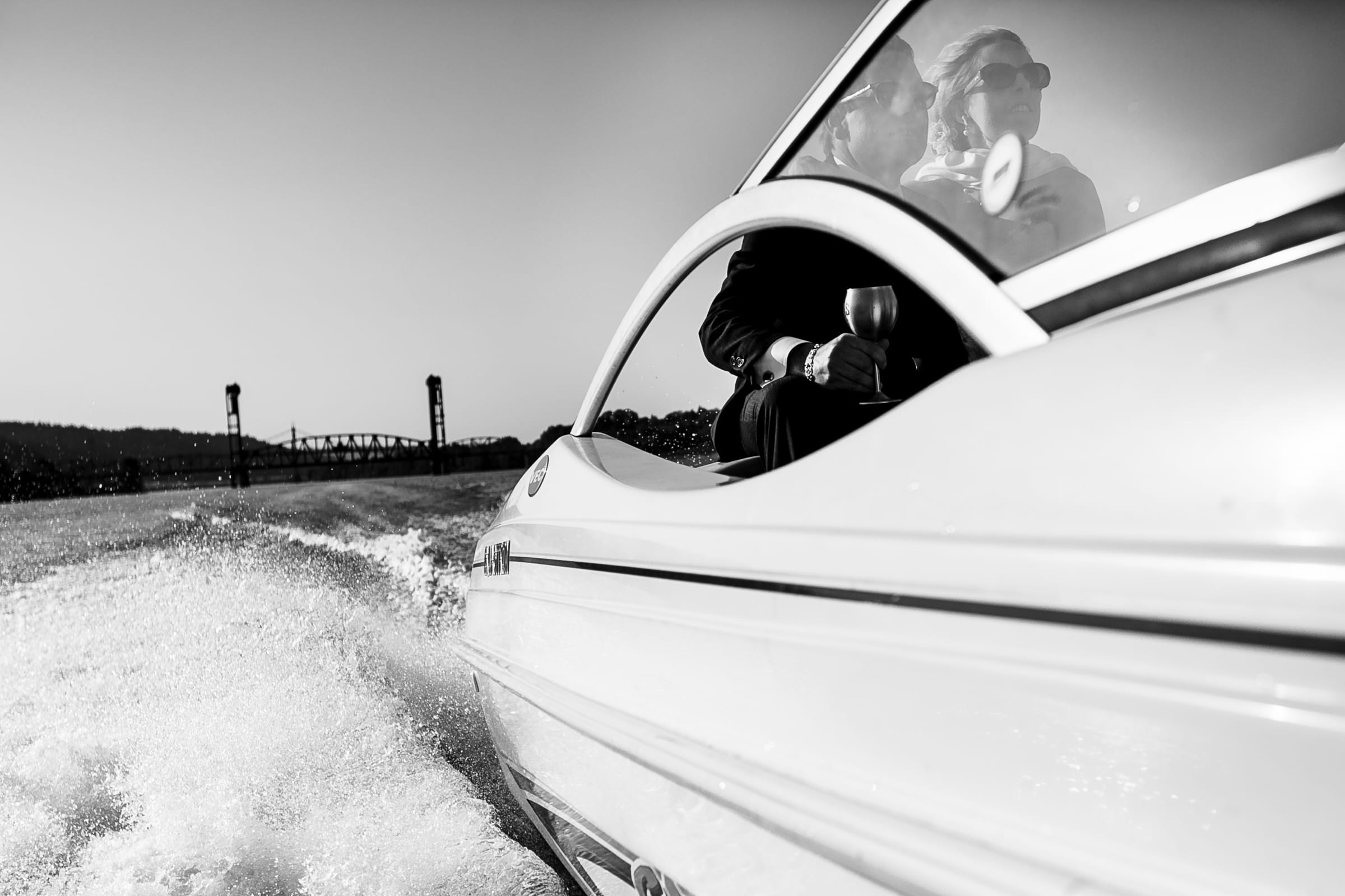 Bride and groom on a speed boat moments aftertheir outdoor small Cathedral Park Wedding ceremony in Portland Oregon